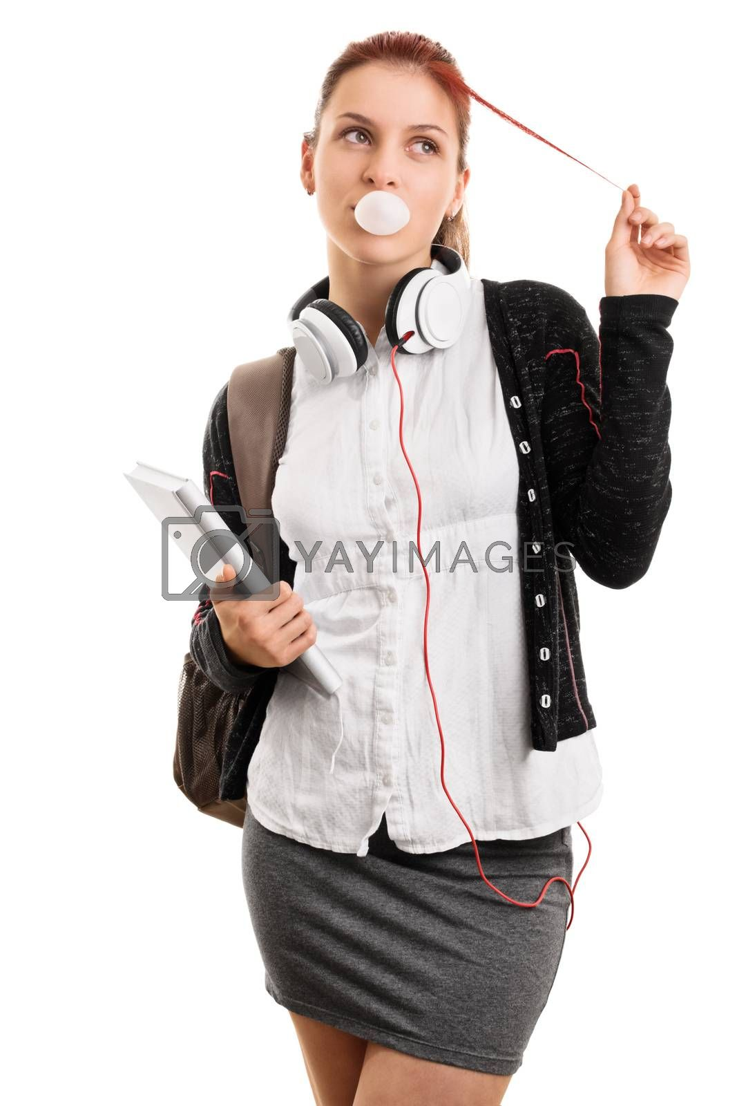 High school lifestyle. Young girl with books and backpack making bubble gum bubbles, playing with her hair, isolated on white background. Most popular girl in school.