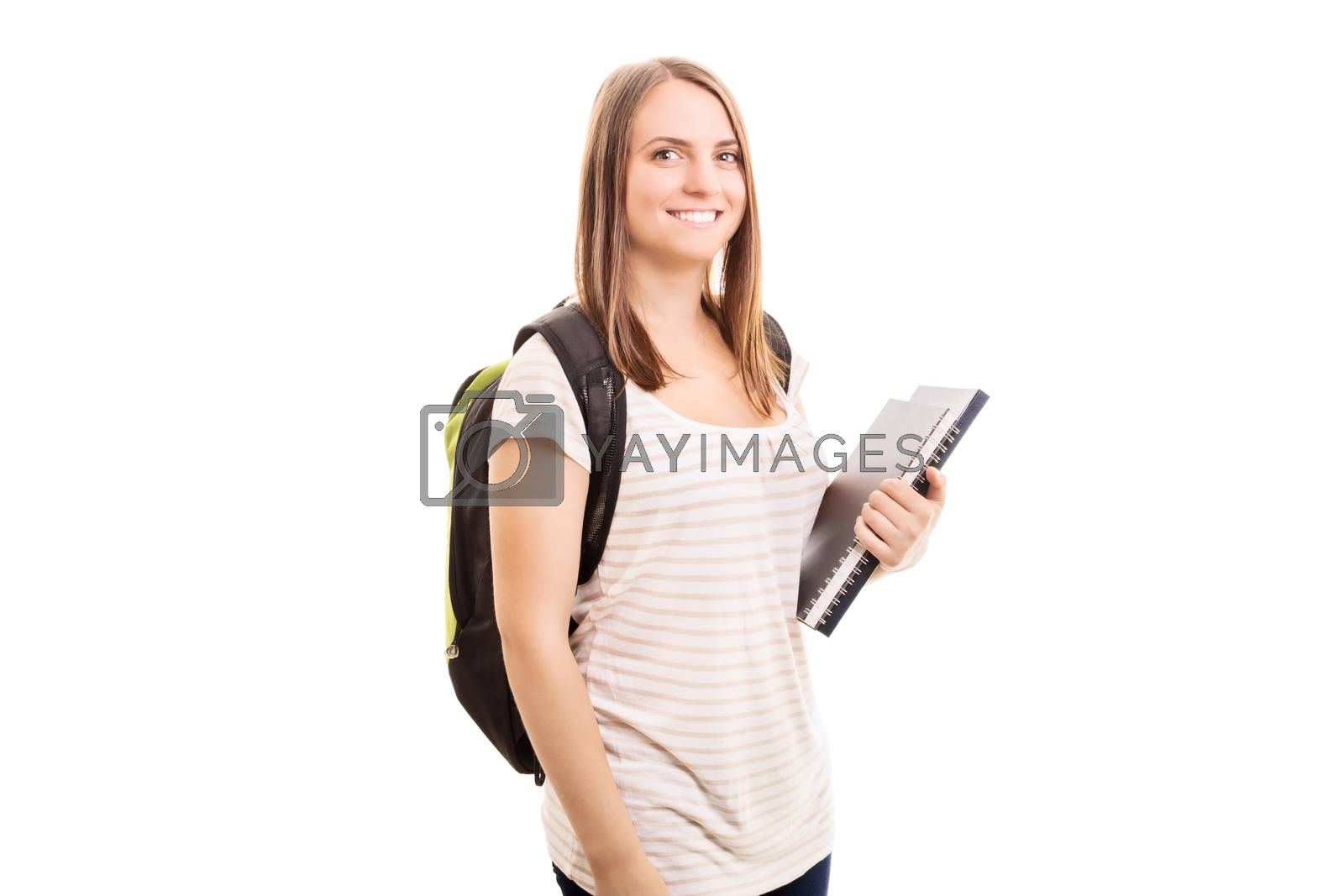 Back to school, finally! Young girl carrying a backpack, some books while going to school, isolated on white background.