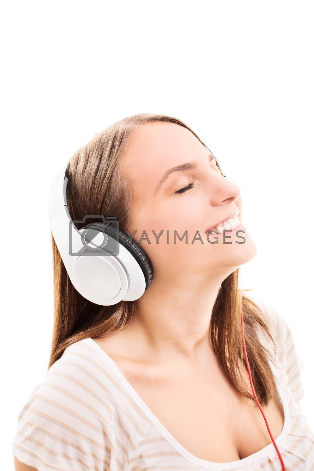 Beautiful young girl with headphones listening to music, isolated on white background.