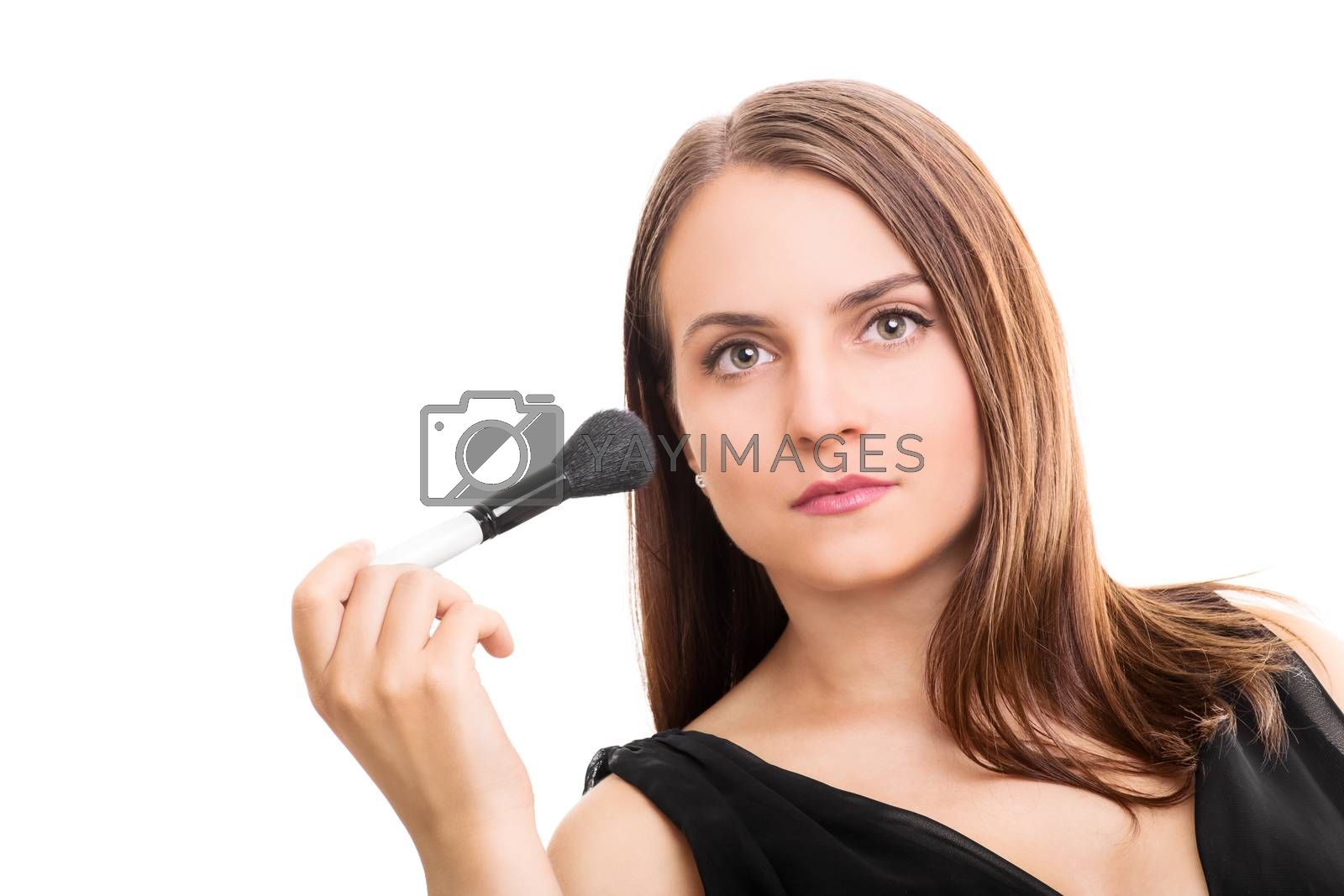 Beautiful young woman holding a make up brush isolated on white background