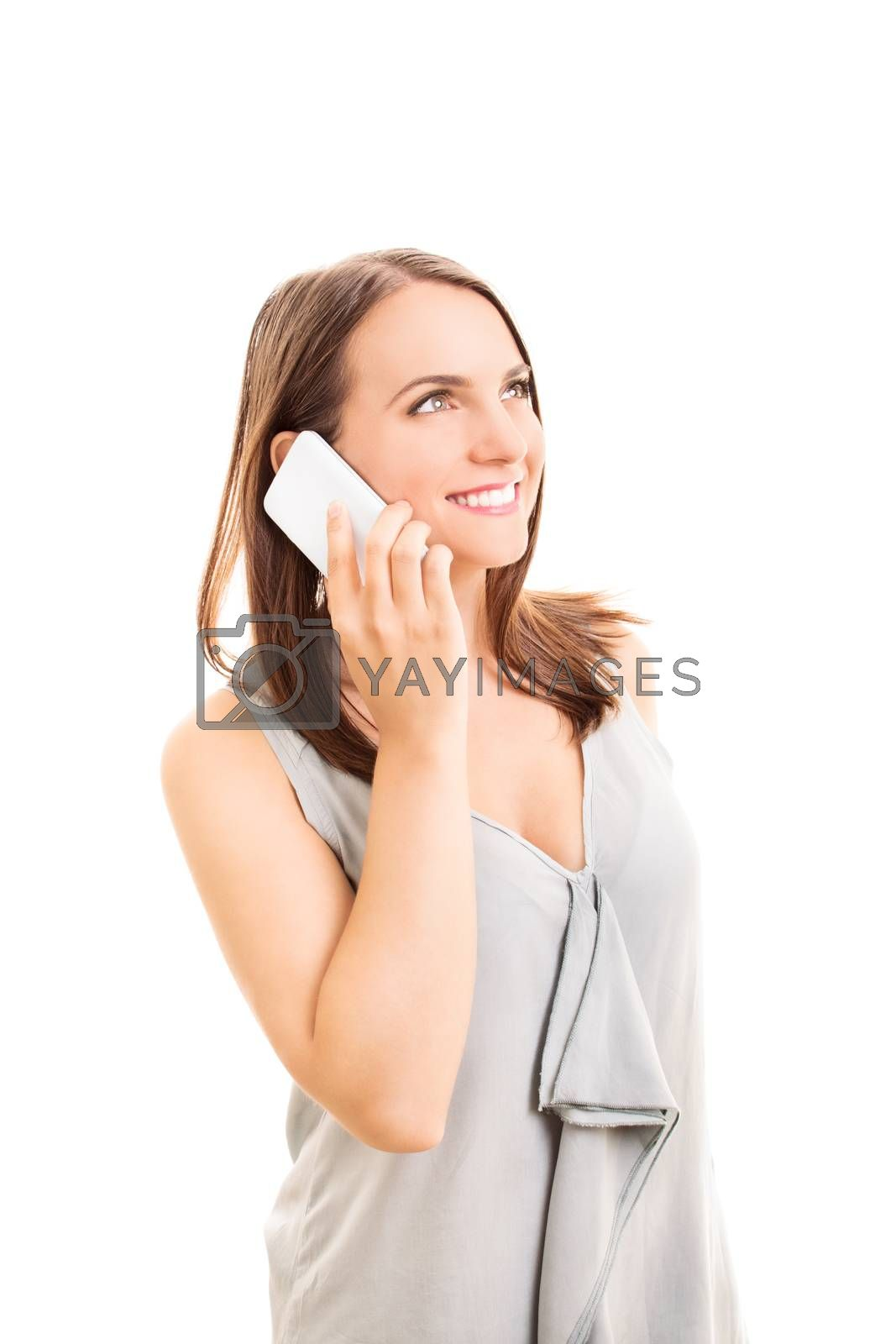 Smiling beautiful young woman talking on a phone, isolated on white background.