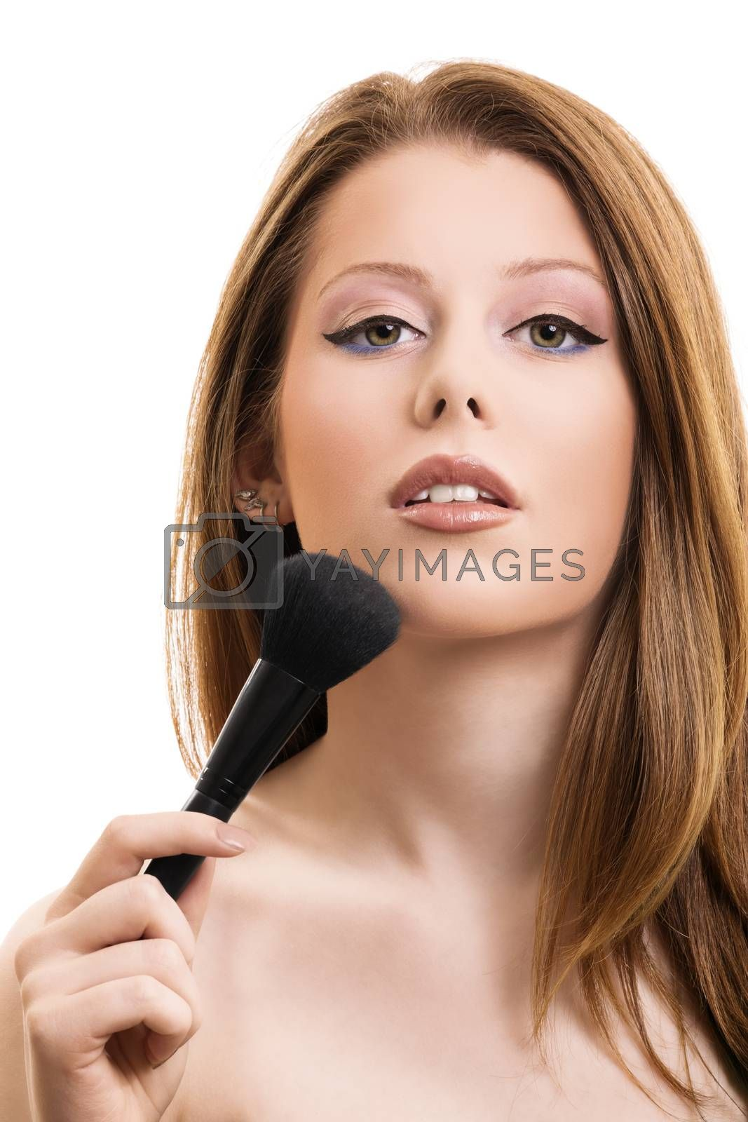 A portrait of a beautiful woman applying makeup, isolated on white background. Natural beauty look.