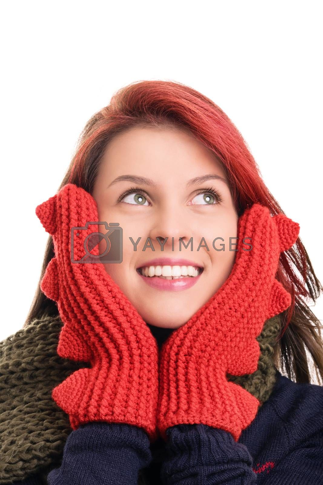 A portrait of a smiling beautiful young girl in red winter gloves, isolated on white background.
