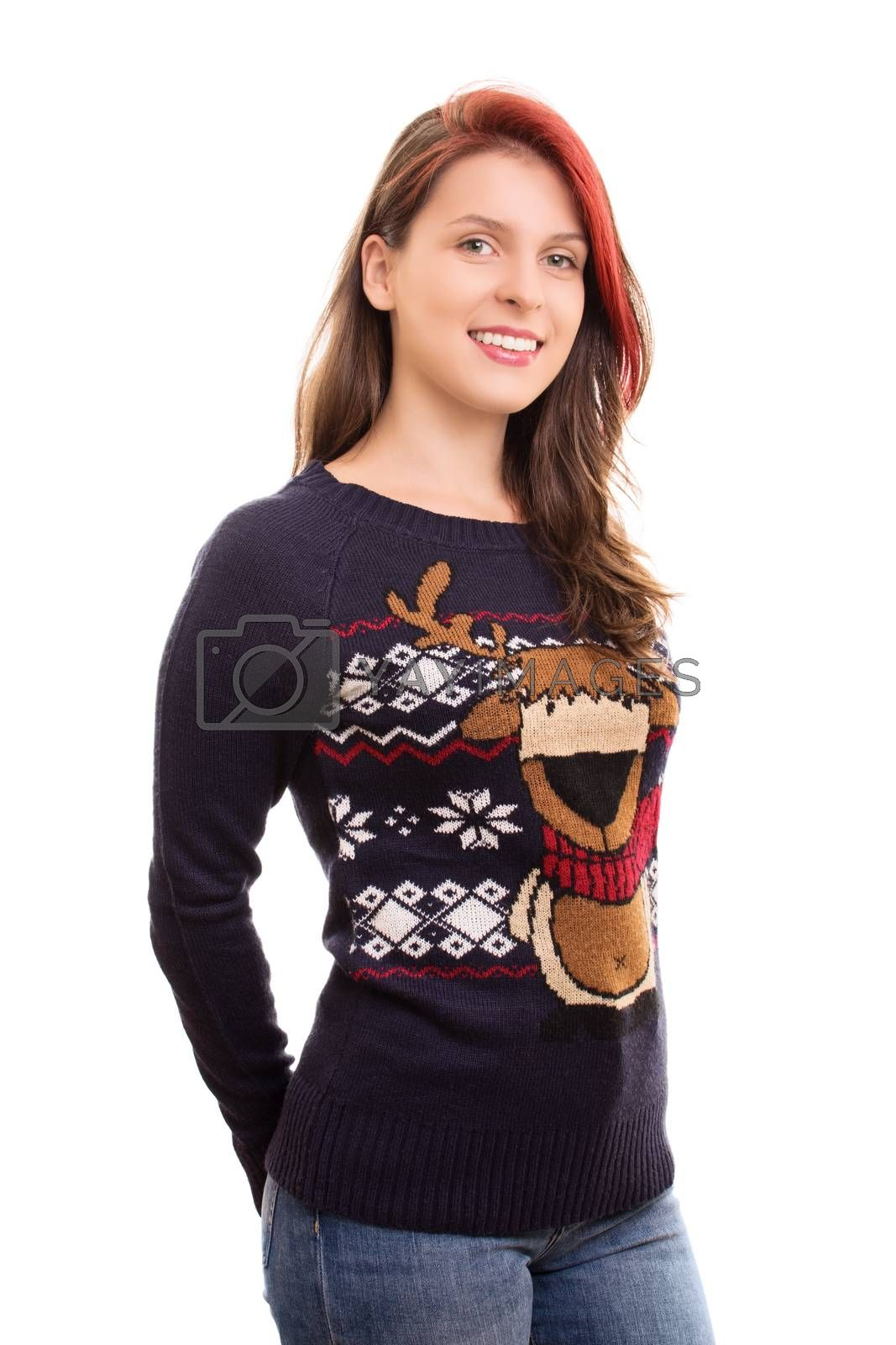 A portrait of a smiling beautiful young girl in christmas sweater, isolated on white background.