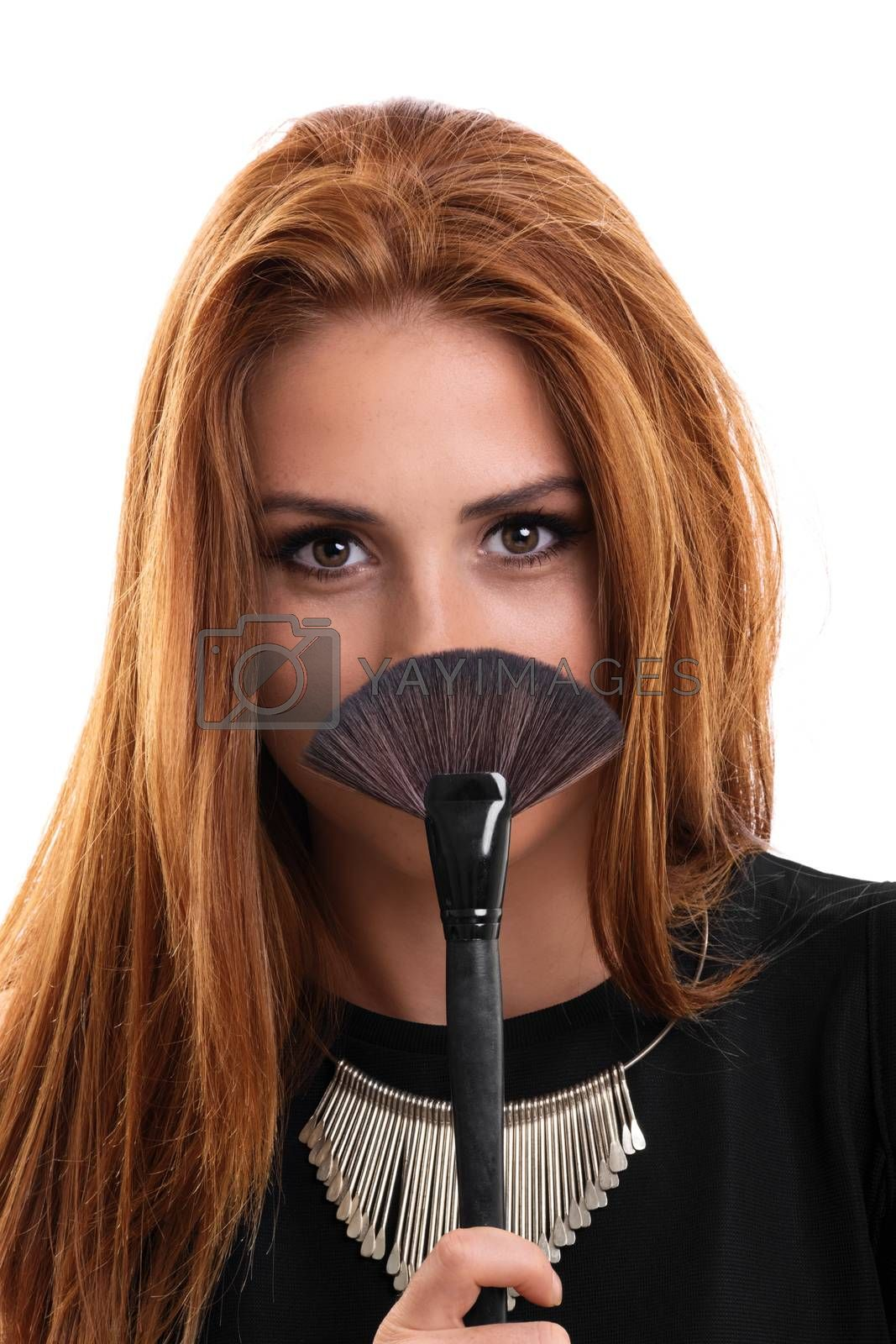 A portrait of a beautiful young girl holding a make up brush, isolated on white background.