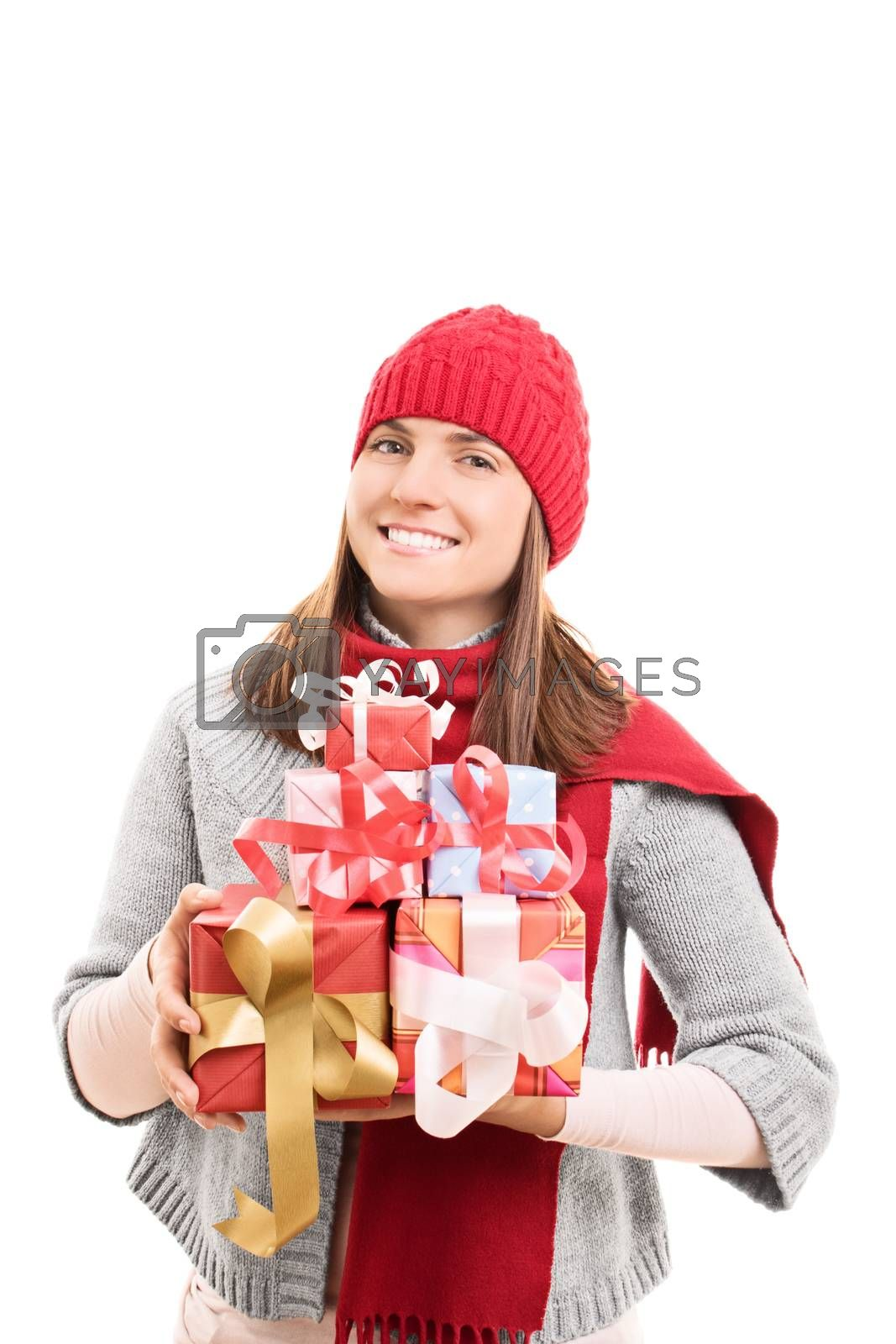 My Christmas shopping is done. Beautiful young woman in winter clothes holding wrapped presents, isolated on white background.