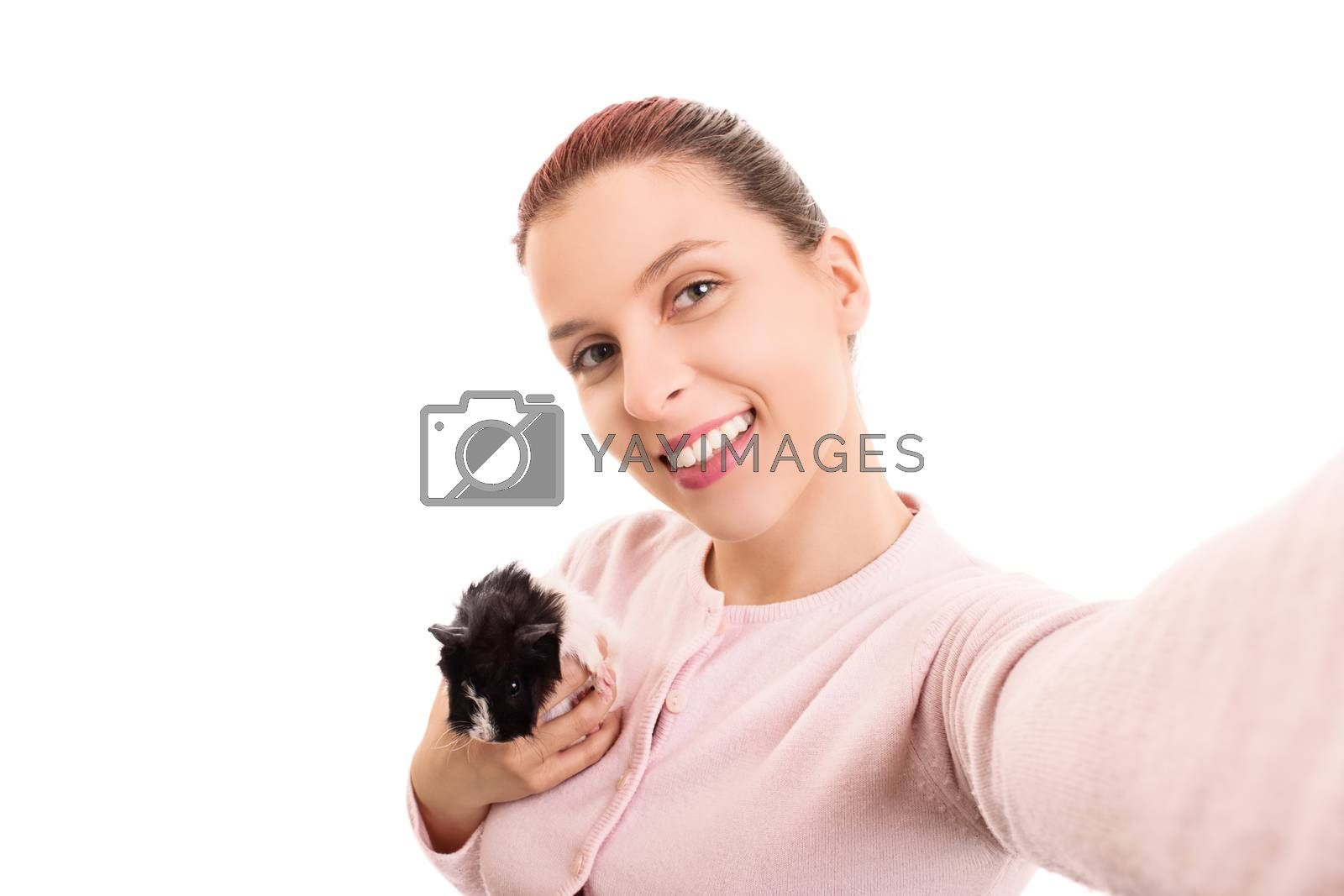 Smiling beautiful young girl with her pet guinea pig taking a selfie, isolated on white background.