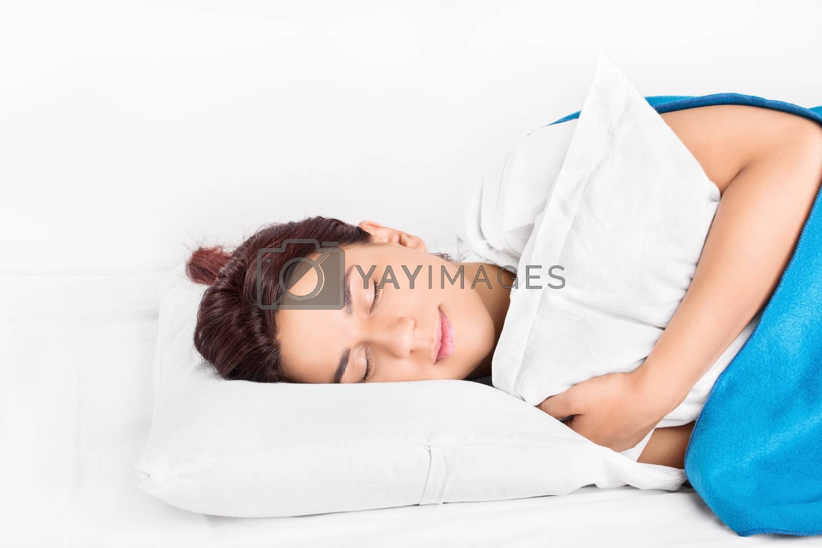 Beautiful young girl sleeping and hugging a pillow, isolated on white background.