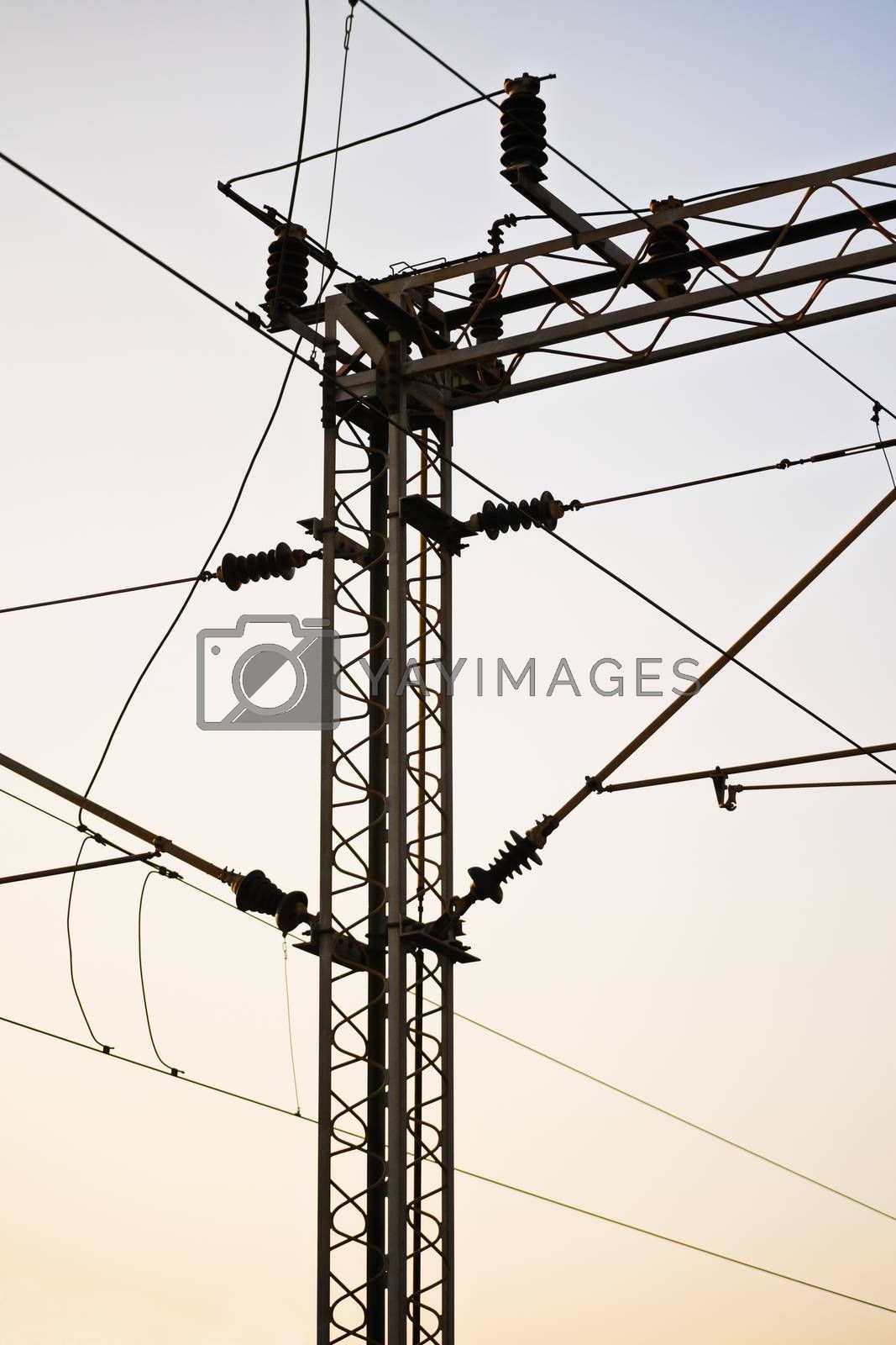 Railroad power transmission line tower during sunset.