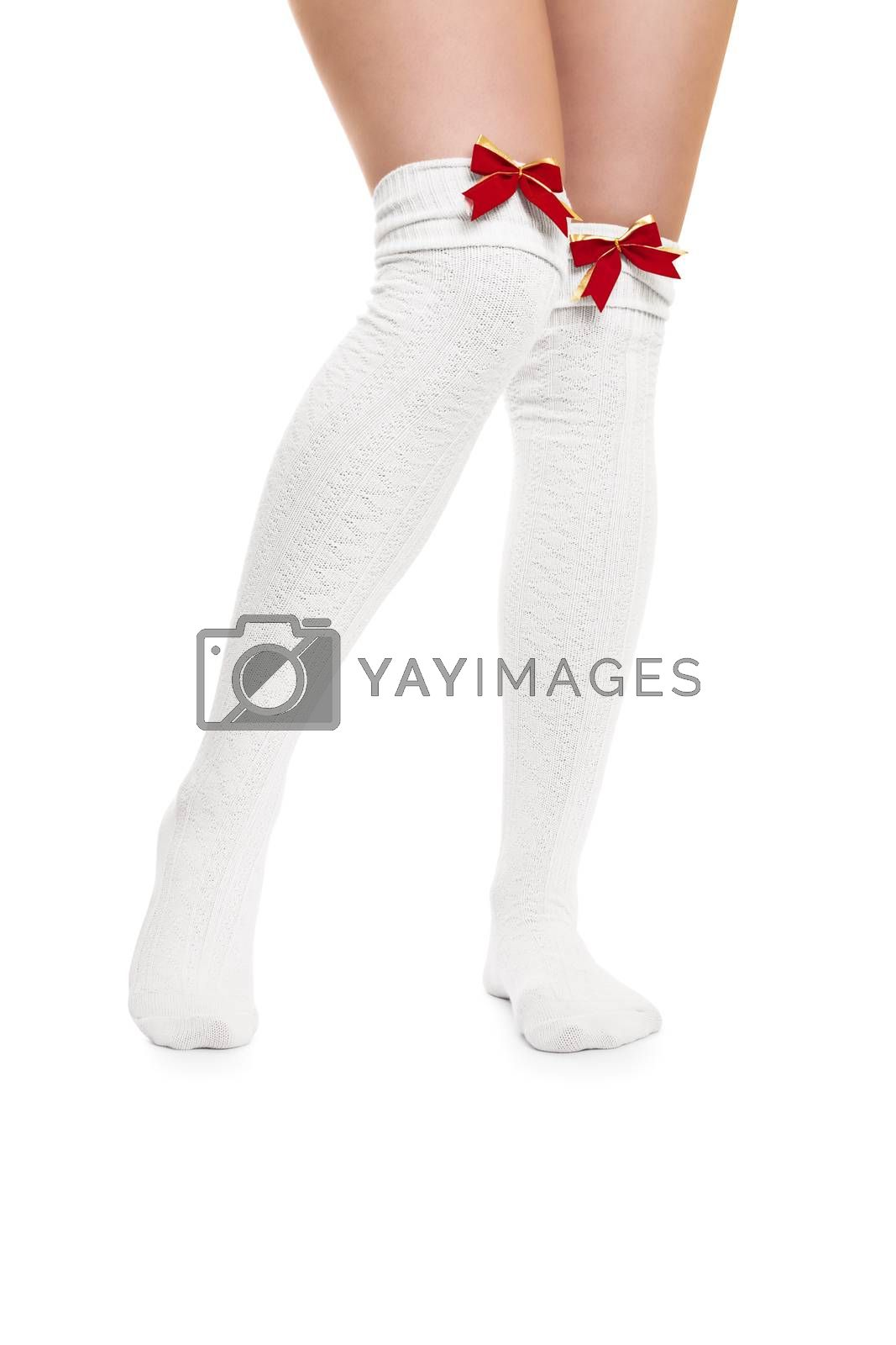 Sexy female legs in white stockings with red bow ties, isolated on white background.