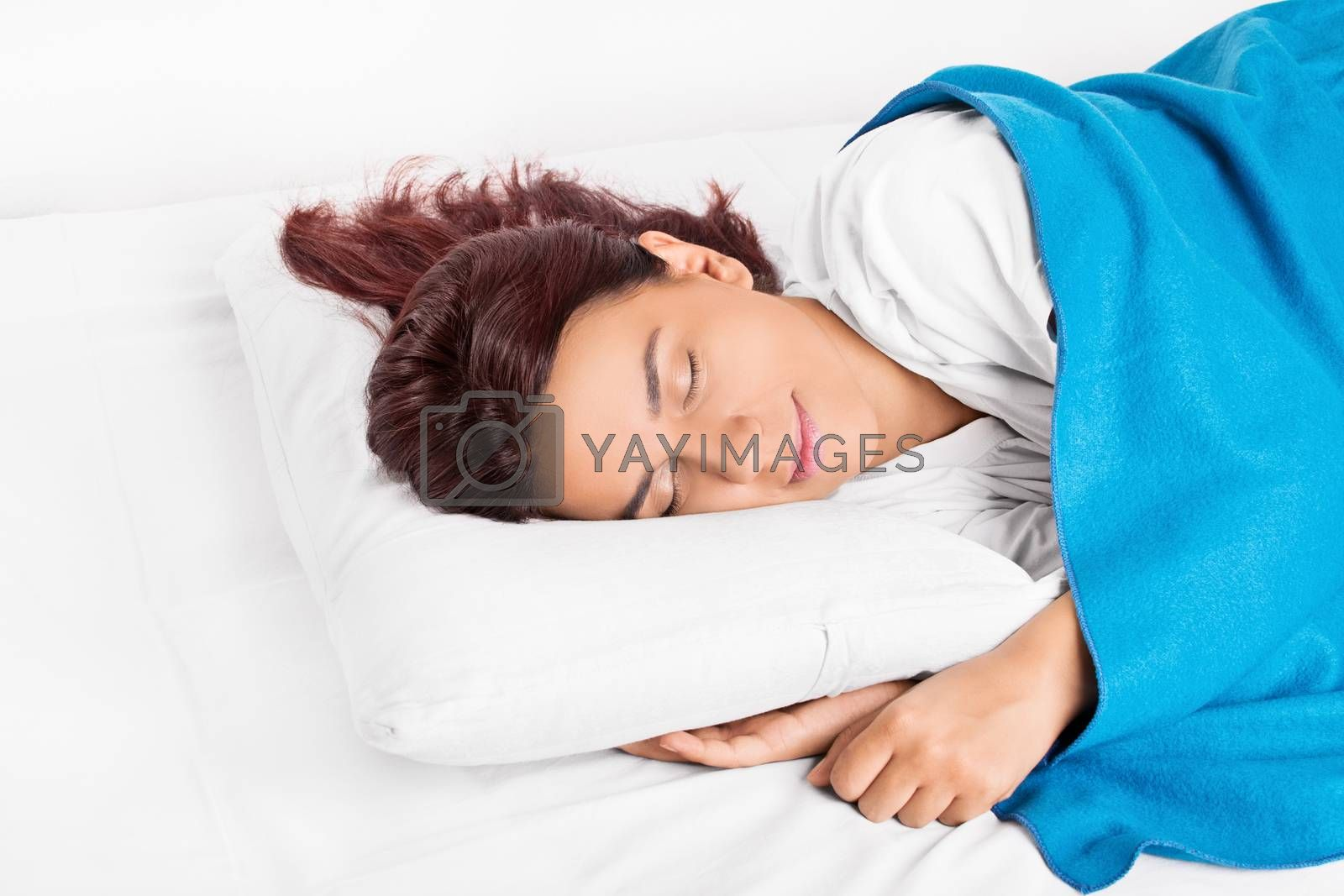 Close up shot of a beautiful young girl comfortably sleeping in bed.