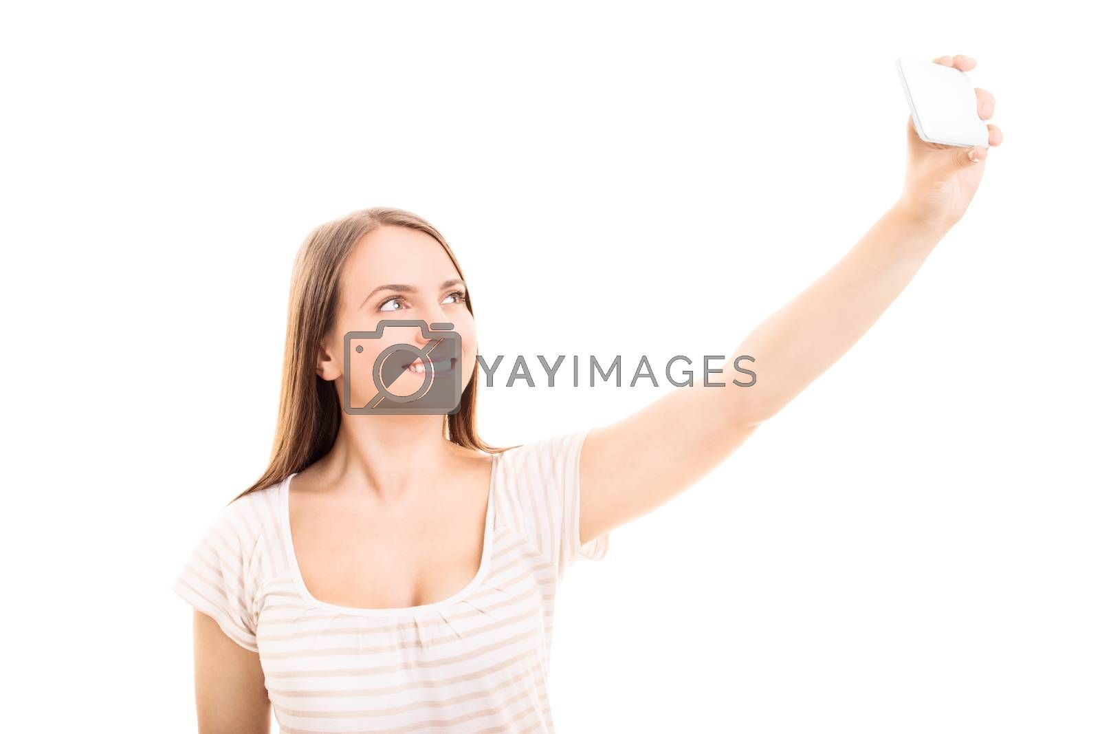 Beautiful smiling young girl taking a selfie, isolated on white background.