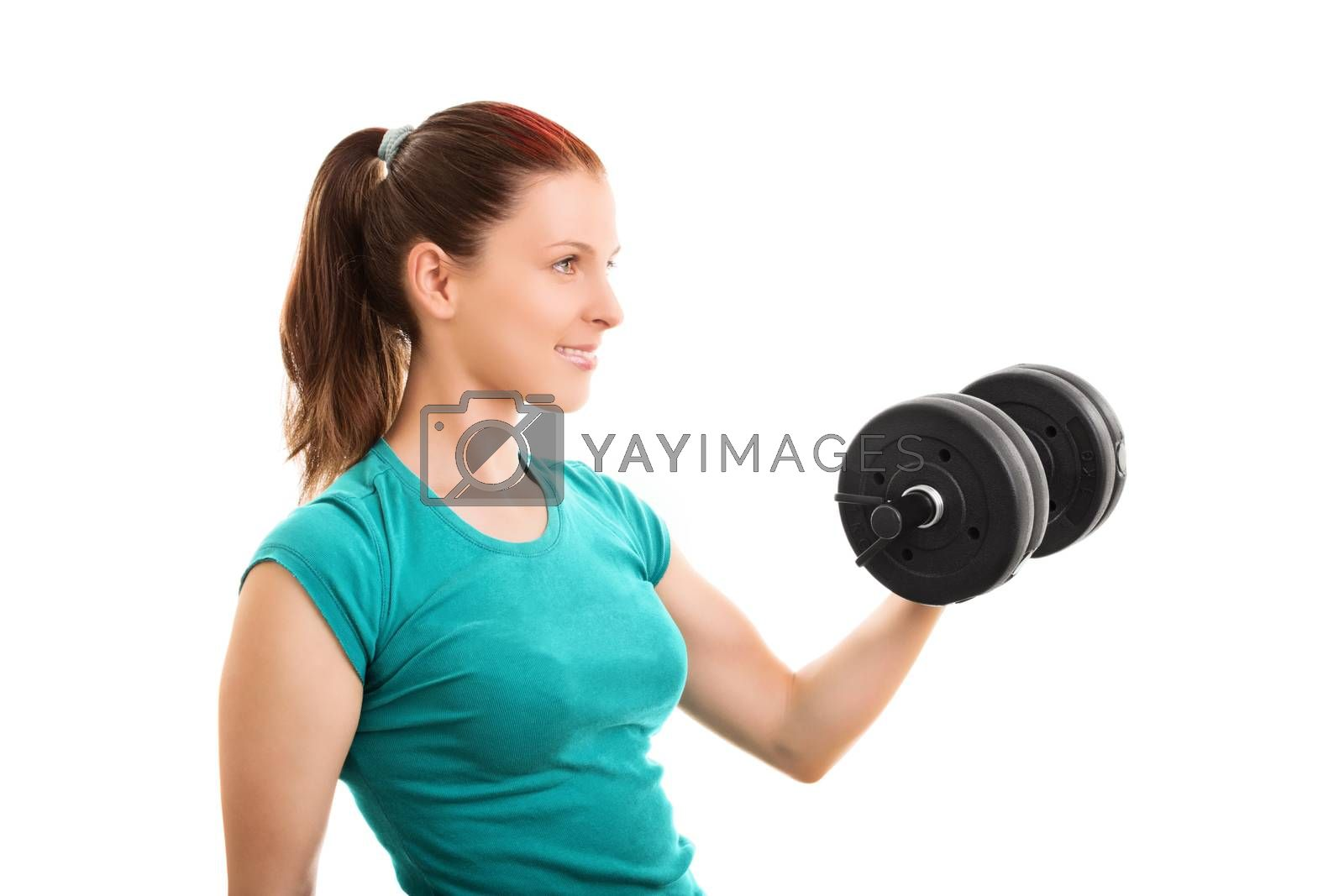 A portrait shot of a beautiful fit girl smiling and lifting a dumbbell, isolated on white background.