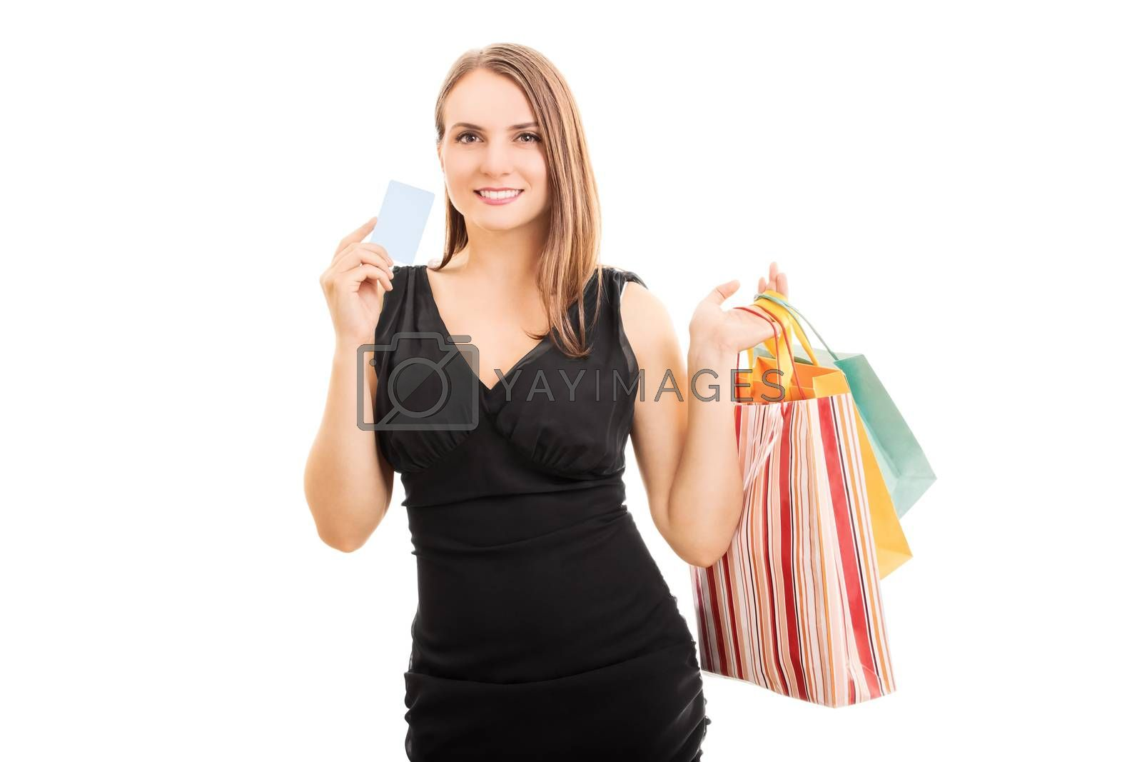 A portrait of an elegant beautiful young woman holding shopping bags and a card, isolated on white background.