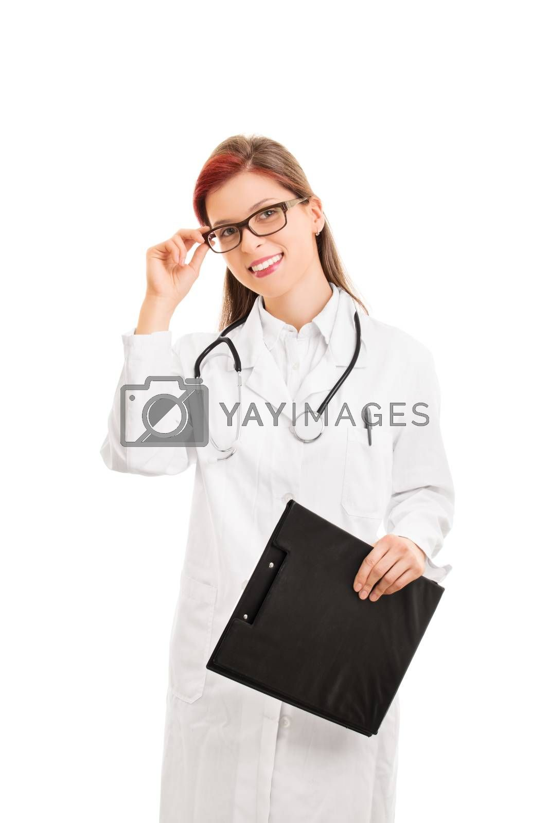 We're here for you. Portrait of a smiling beautiful febale doctor holding a notepad, isolated on white background.
