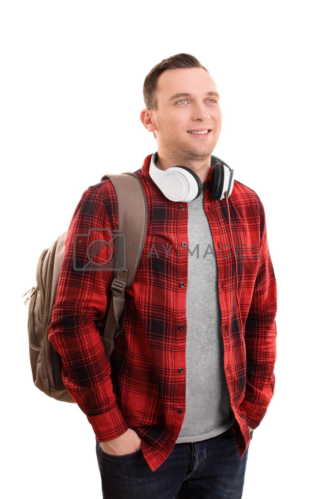 A portrait of a smiling male student, wearing a backpack and headphones, isolated on white background.