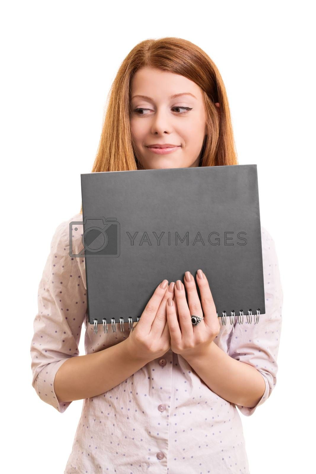 A portrait of a smiling beautiful girl, holding a book, isolated on white background.