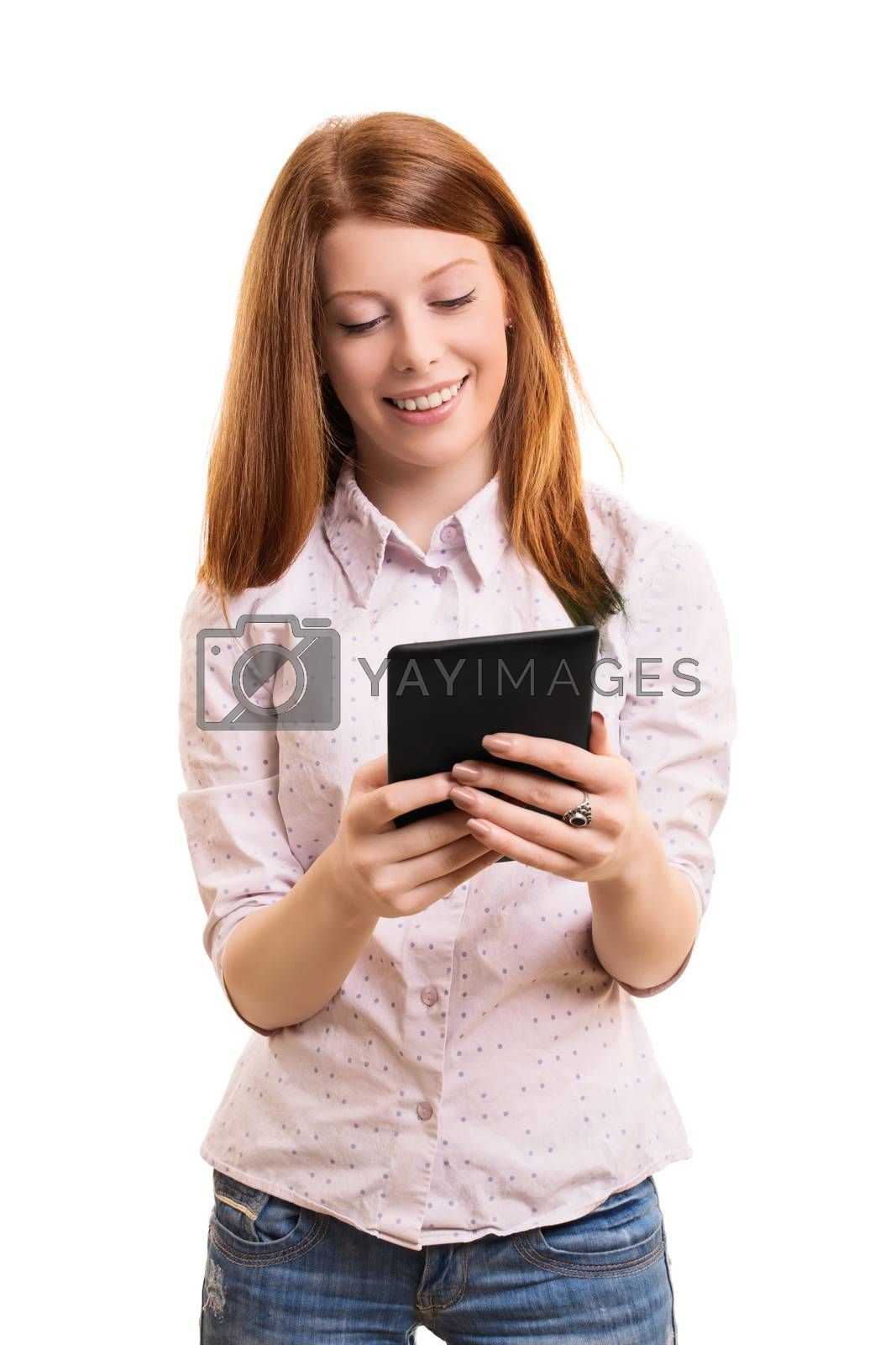 A portrait of a smiling female student holding a tablet, isolated on white background.