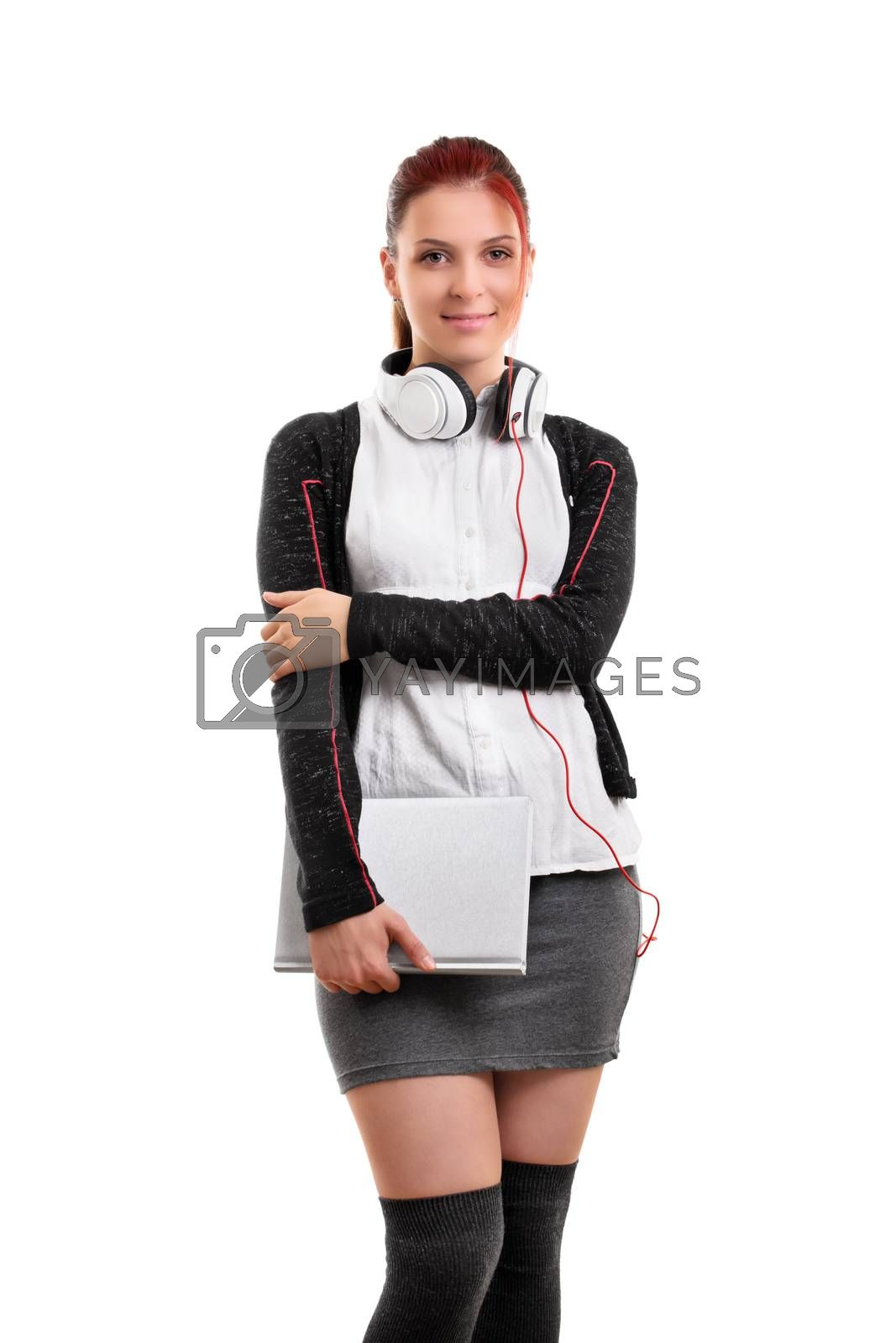Portrait of a beautiful smiling student with headphones and a book, ready for class, isolated on white background.