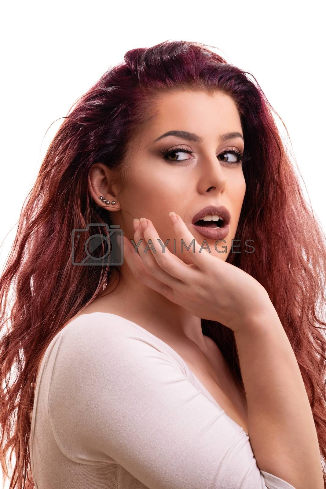 Portrait of a beautiful young surprised girl, isolated on white background.