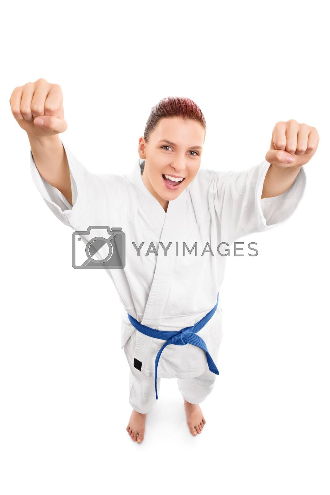 A portrait of a beautiful young girl in a kimono with blue belt cheering, from top perspective, isolated on white background.