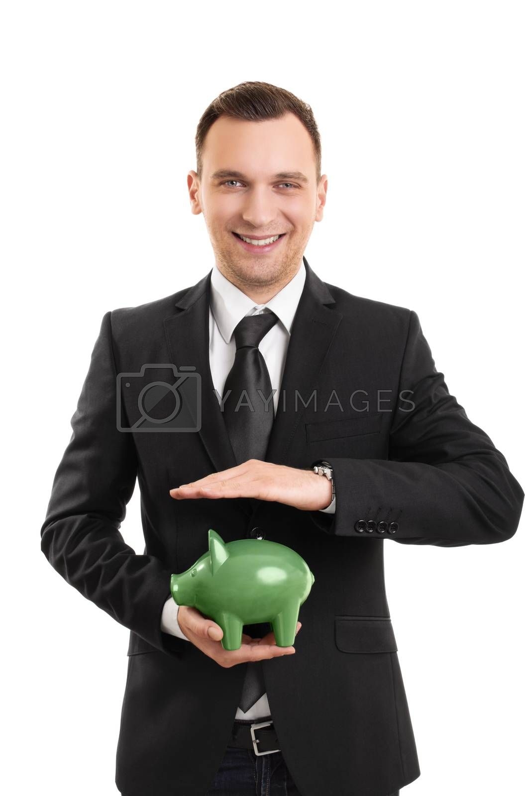 A portrait of a businessman holding a piggy bank, isolated on white background.