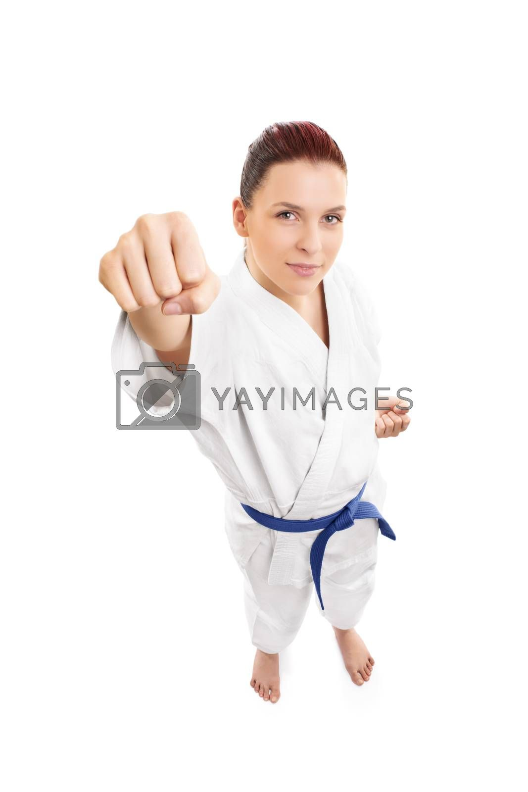 A portrait of a beautiful young female aikido fighter attacking, from top, isolated on white background.