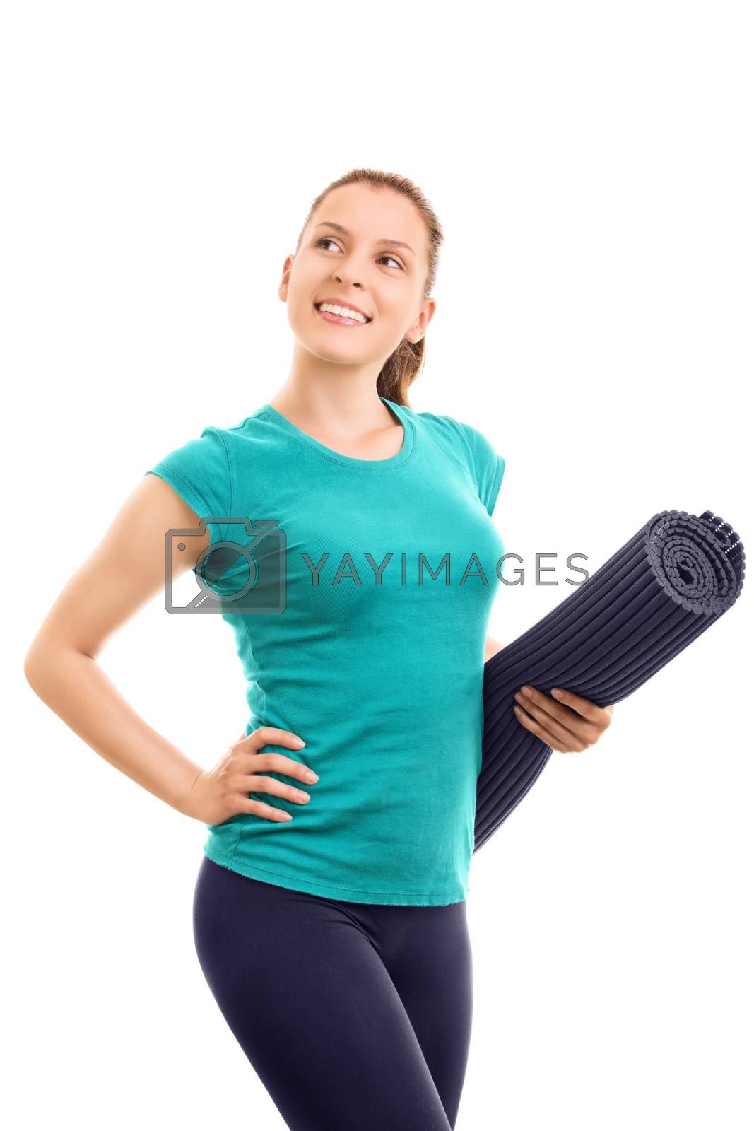 Going out for a workout. Beautiful young girl holding an exercise mat, isolated on white background.
