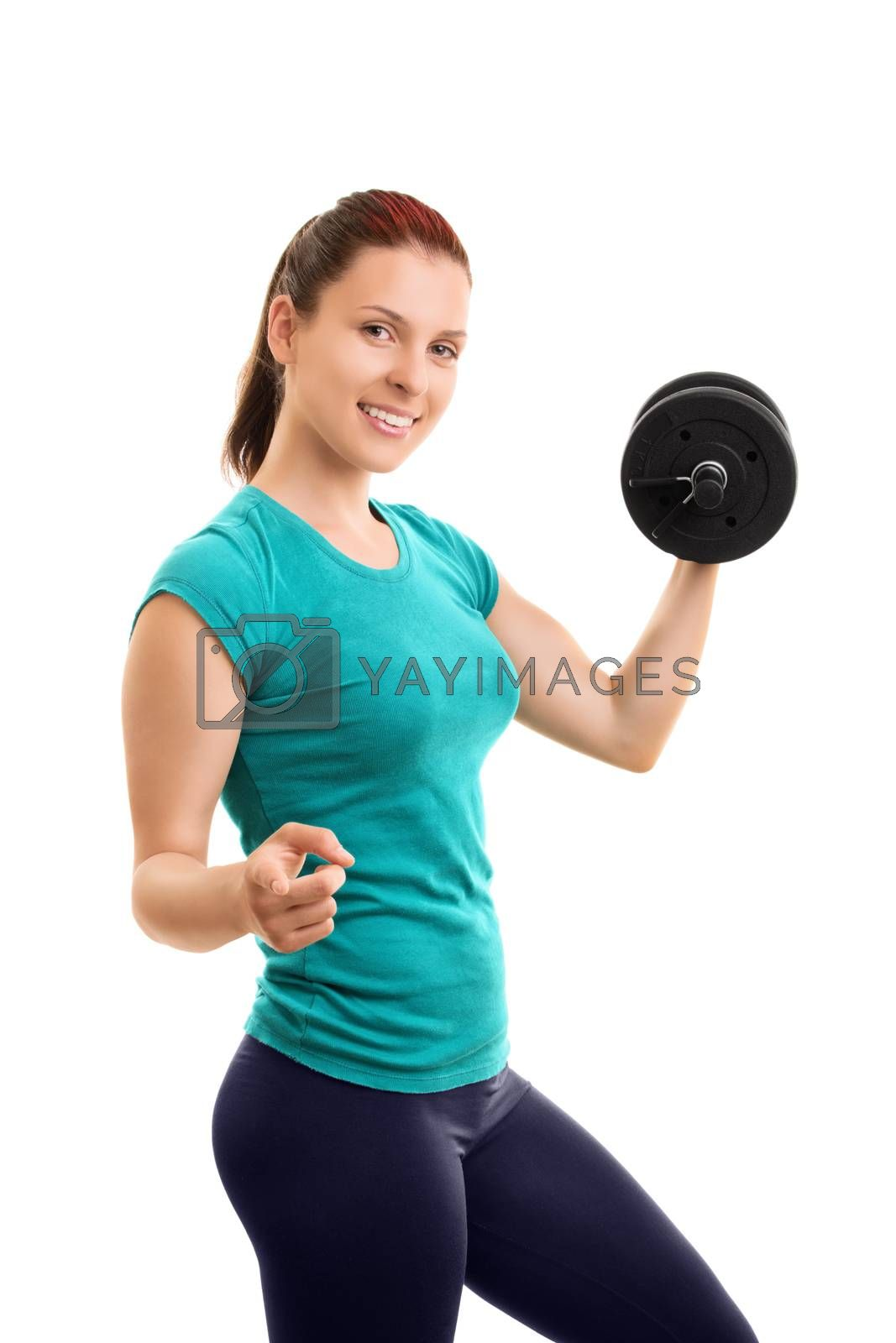 I pull my weight. I exercise. Do you?Beautiful young girl lifting weights and pointing towards you, isolated on white background.