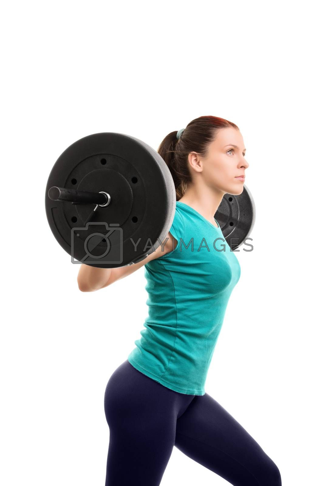 Imagining and getting the perfect you. Beautiful young girl holding a barbell, isolated on white background. Ready for some squats.
