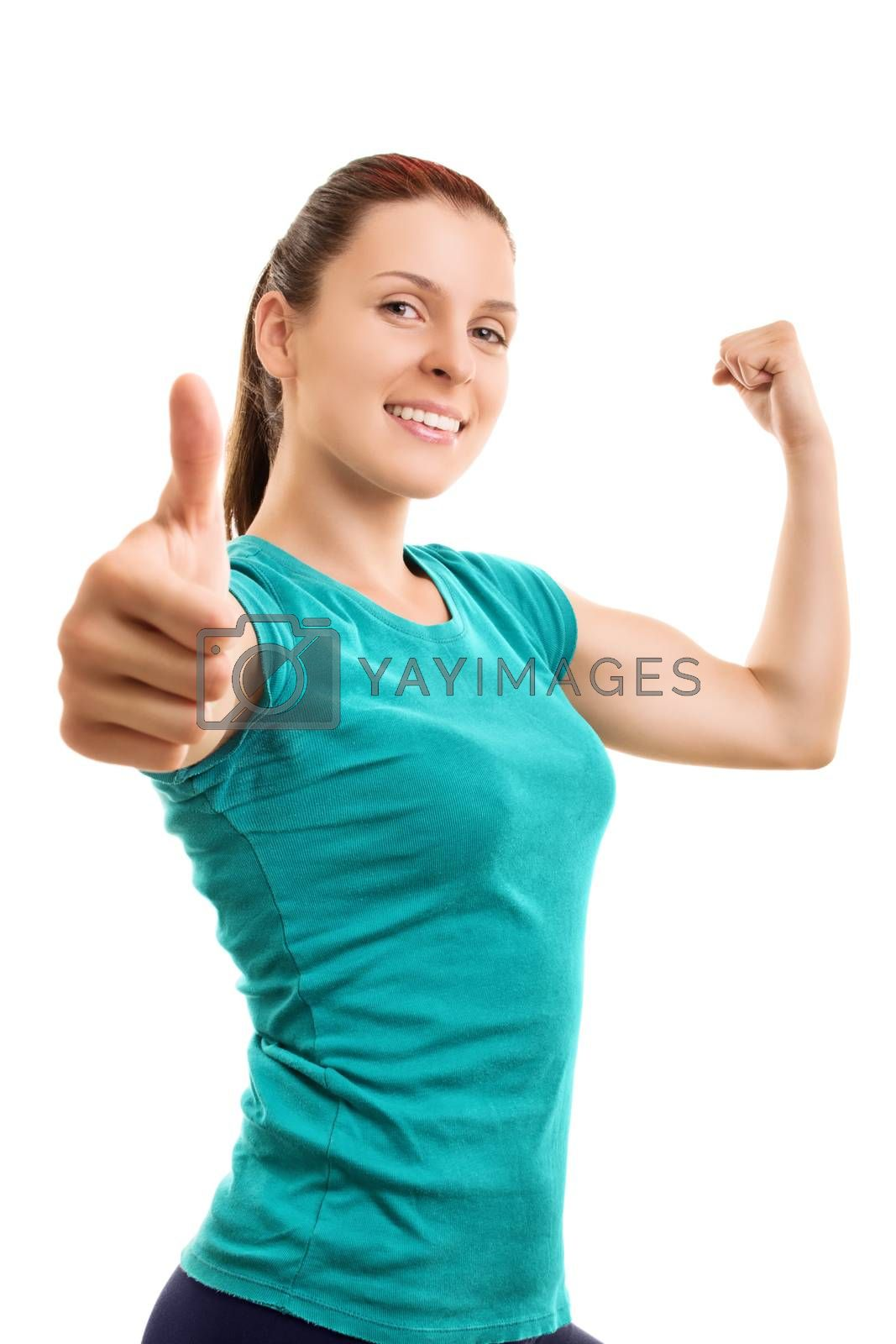Willpower and strength to be fit. Smiling young athlete giving thumbs up, isolated on white background.