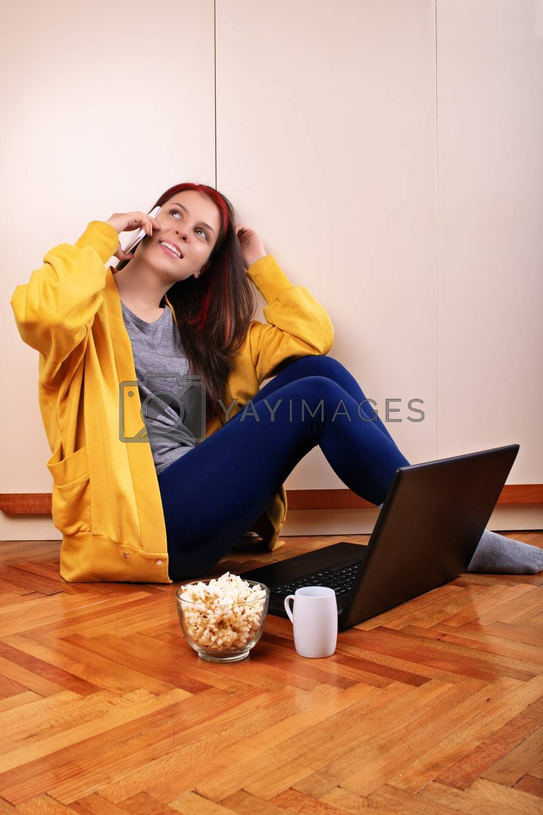 Young girl on her phone preparing to watch a movie by Mendelex