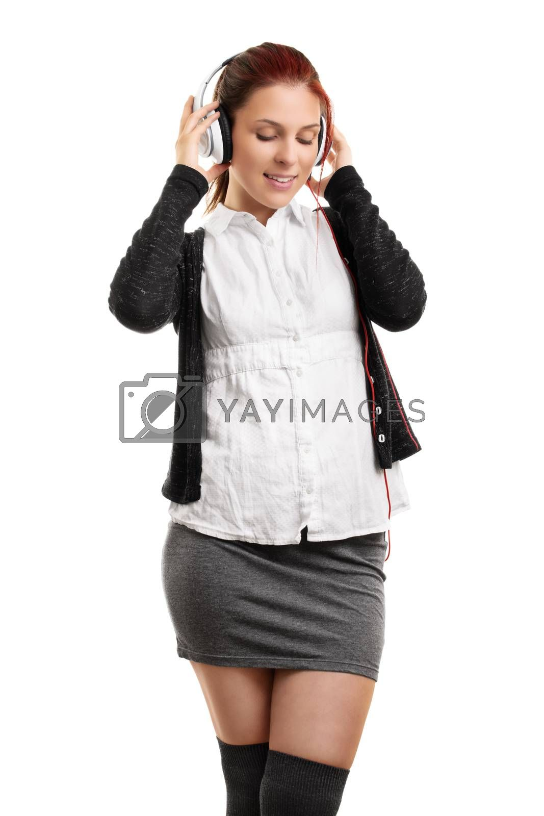 Young woman enjoying music on her headphones by Mendelex