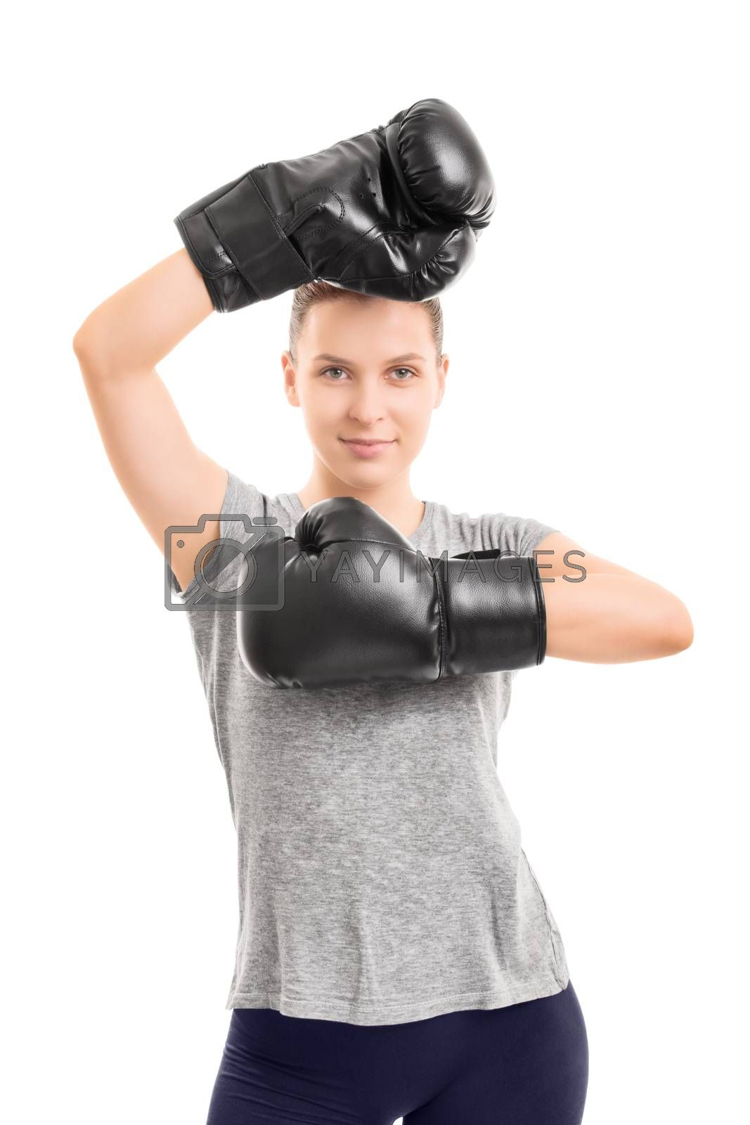 A portrait of a beautiful young girl with boxing gloves, arms raised, isolated on white background.