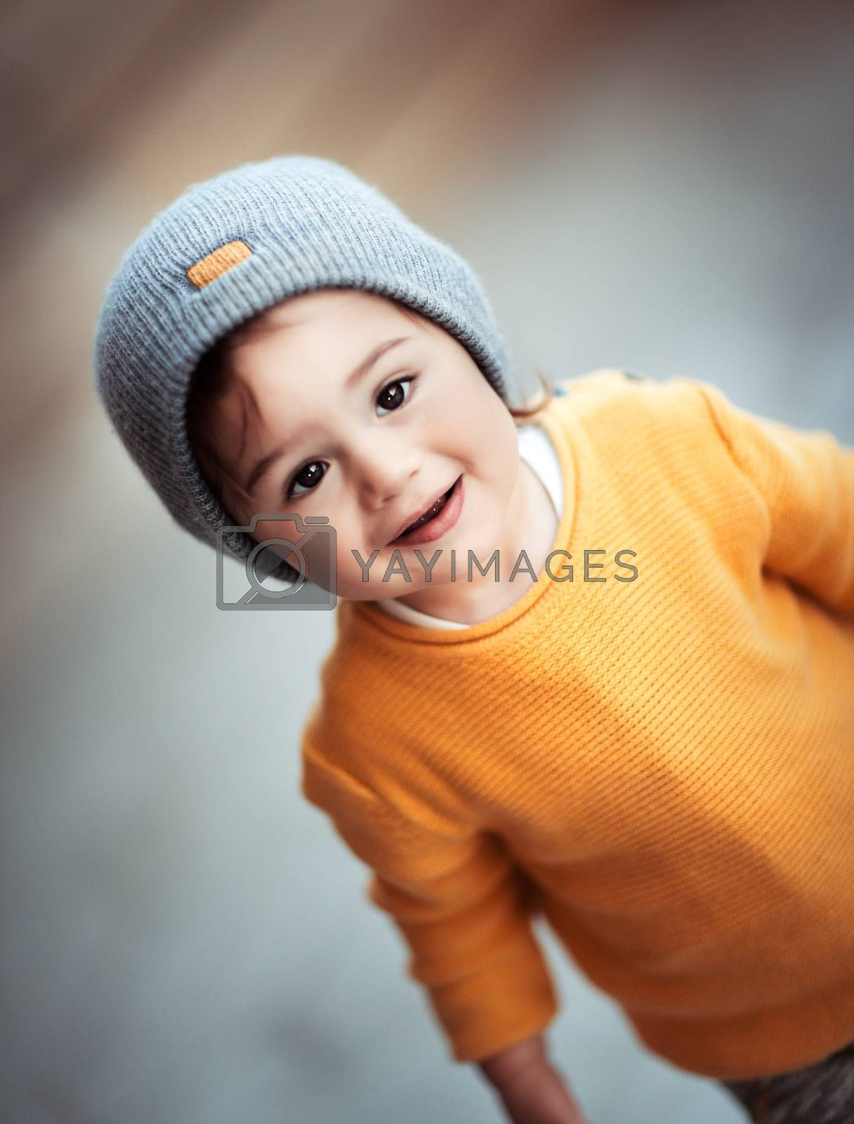 Portrait of a cute happy smiling little baby wearing stylish warm clothes, kids fashion, trendy look in autumn season for boys