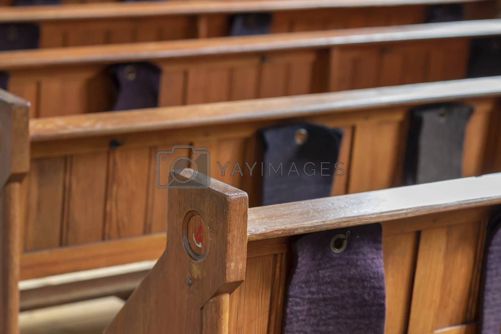 Pews in an old church  by Tofotografie