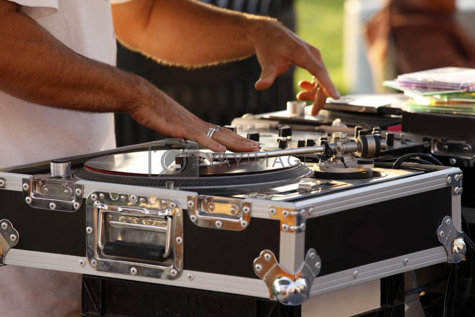 Turntable, hand of dj on the vinyl record on Venice Beach. California, USA