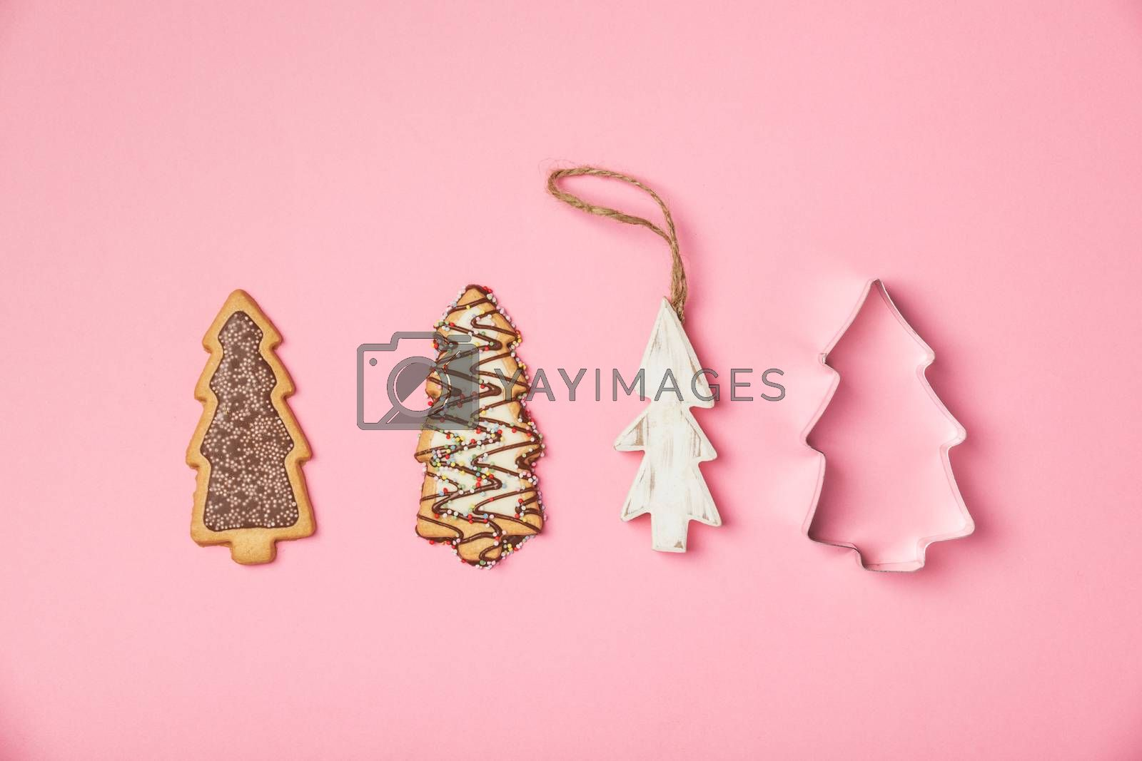 Christmas gingerbread cookies in the shape of a Christmas tree, flat lay