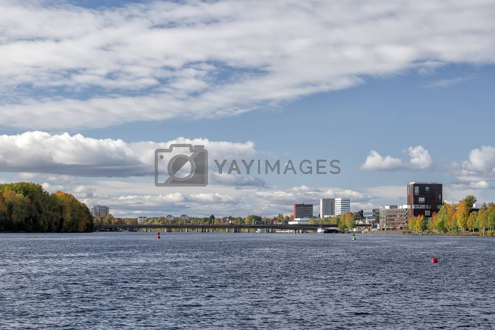 Downtown Umeå, Sweden in Fall with a partly cloudy sky.