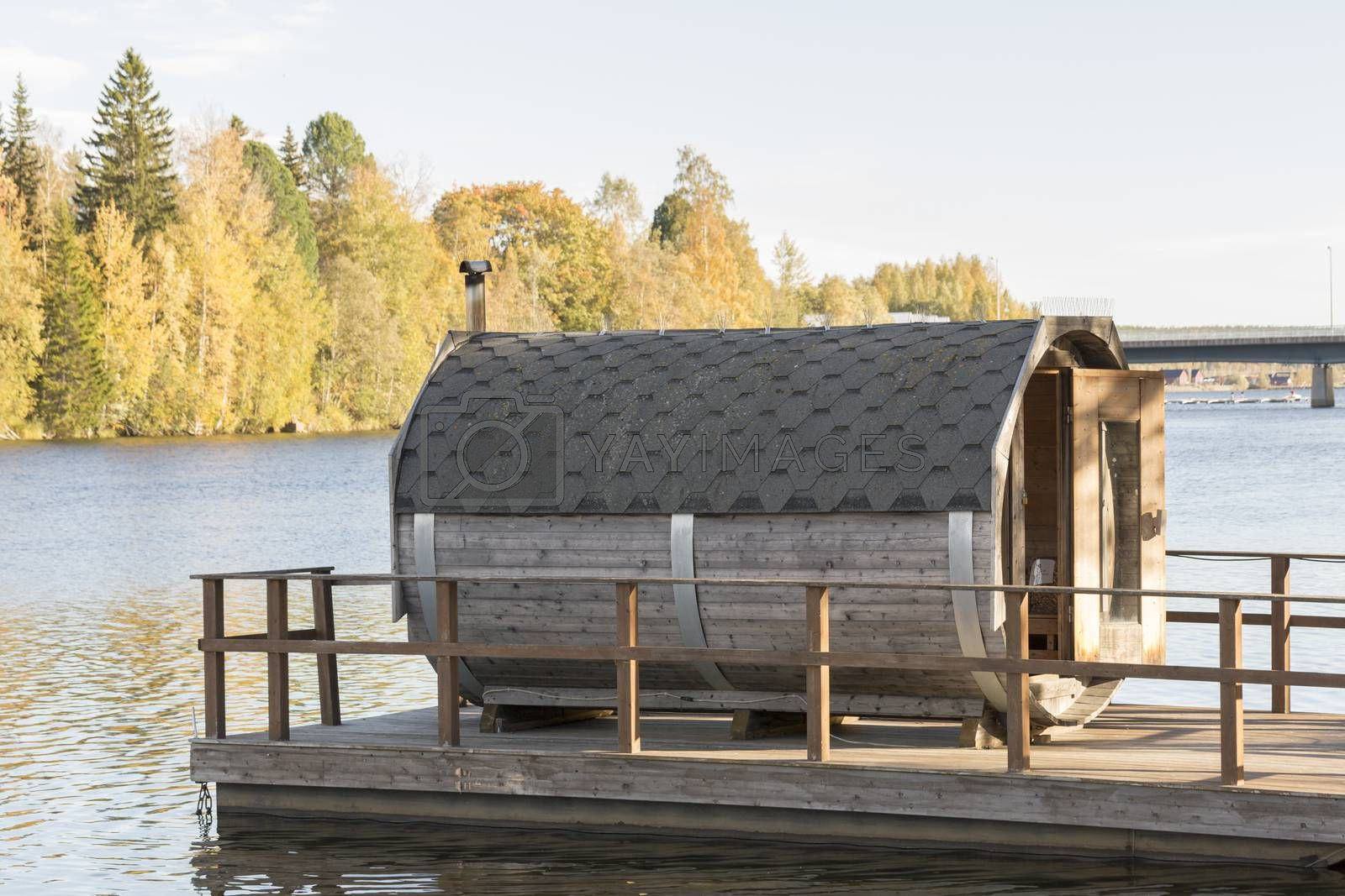 Sauna Floating on River in autumn.