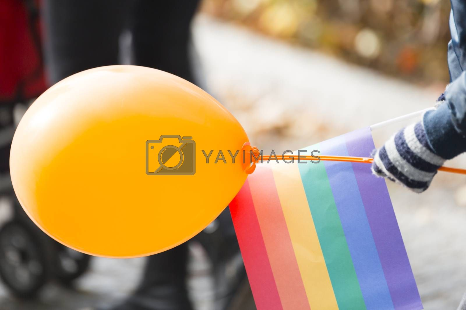 Child with Balloon and Ranbow Flag.