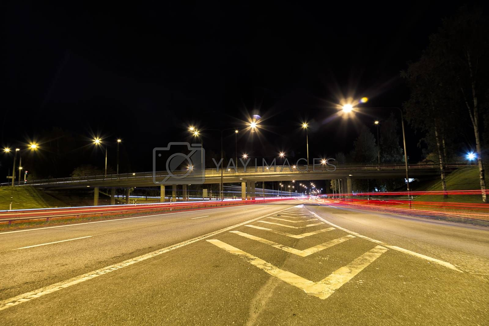 Royalty free image of Highway in Sweden with light trails by Emmoth