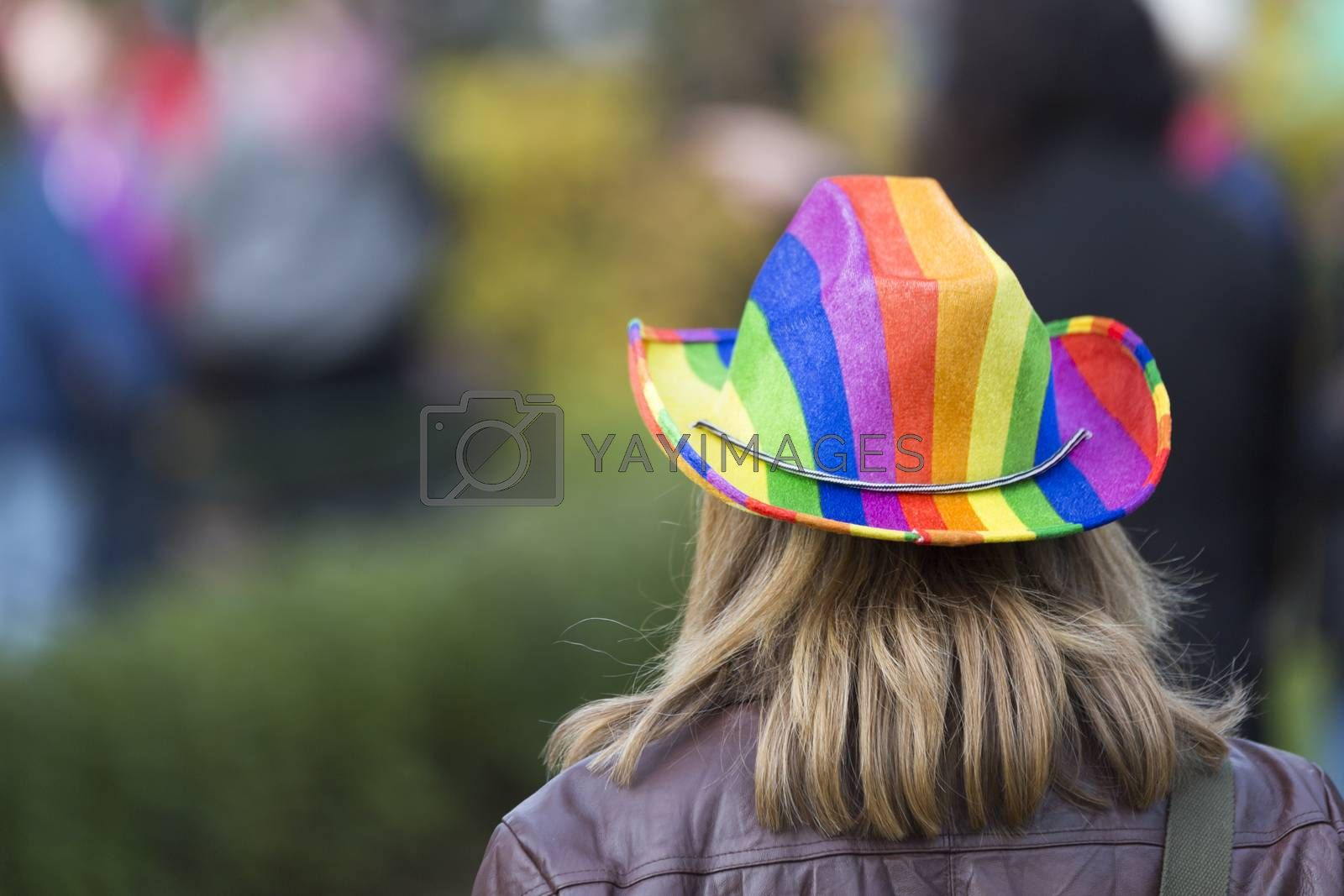 Female with Rainbow Coloured Hat in Pride Parade.
