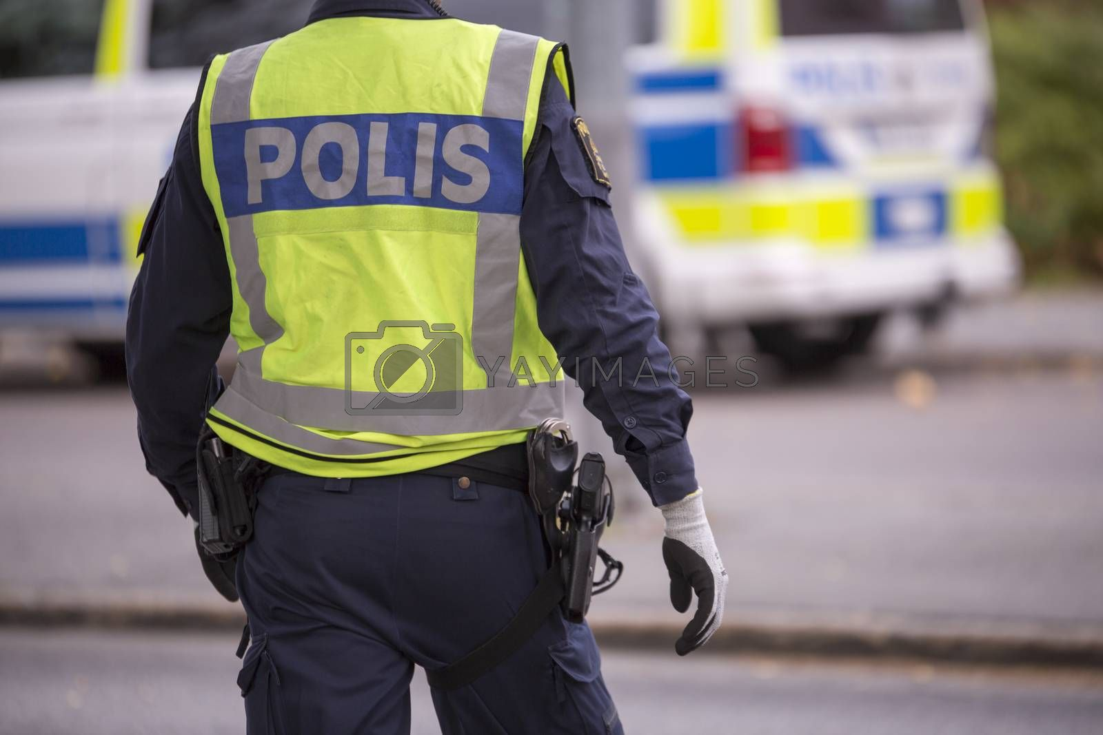 Royalty free image of Swedish Police Officer with Reflective Vest and gun by Emmoth
