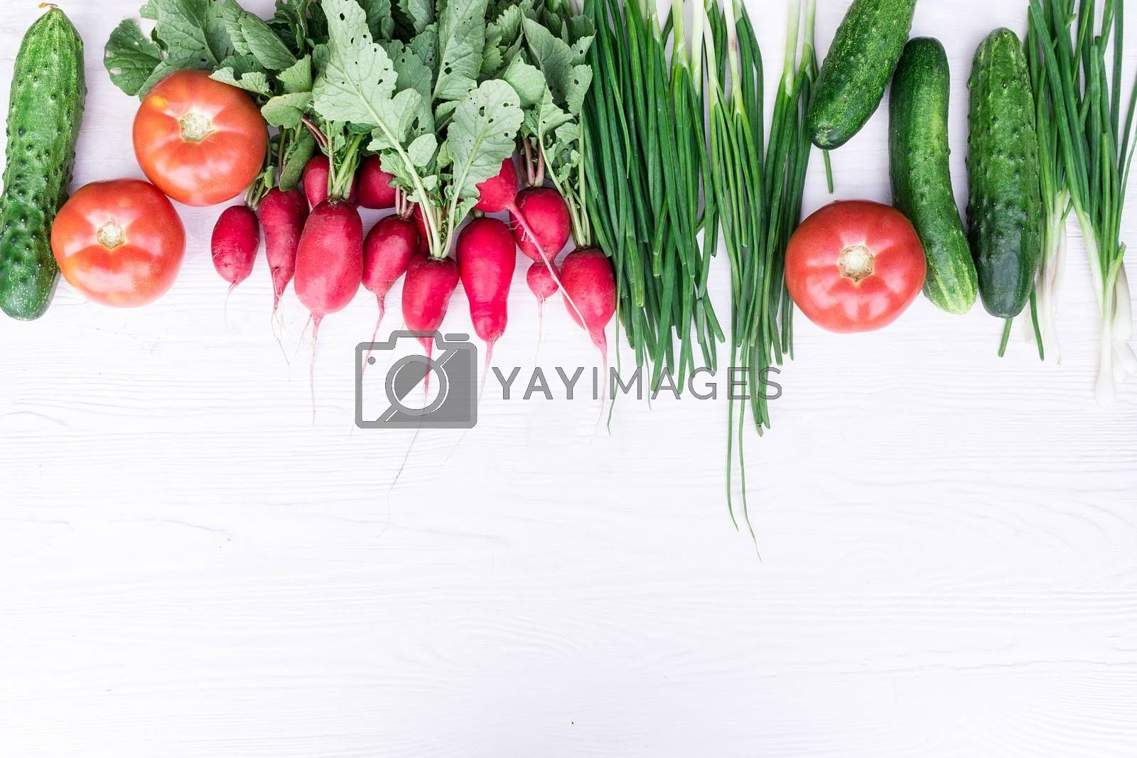 Fresh vegetables from the garden on a white background