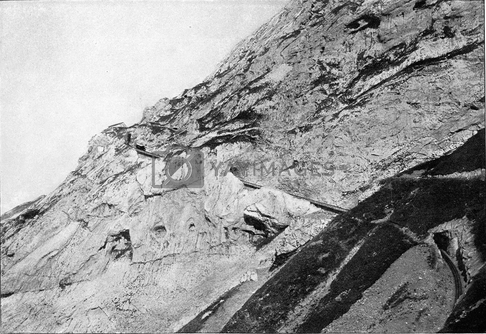The Evel slope at Mount Pilatus and the cogwheel railway leading to its summit, vintage engraved illustration. From the Universe and Humanity, 1910.