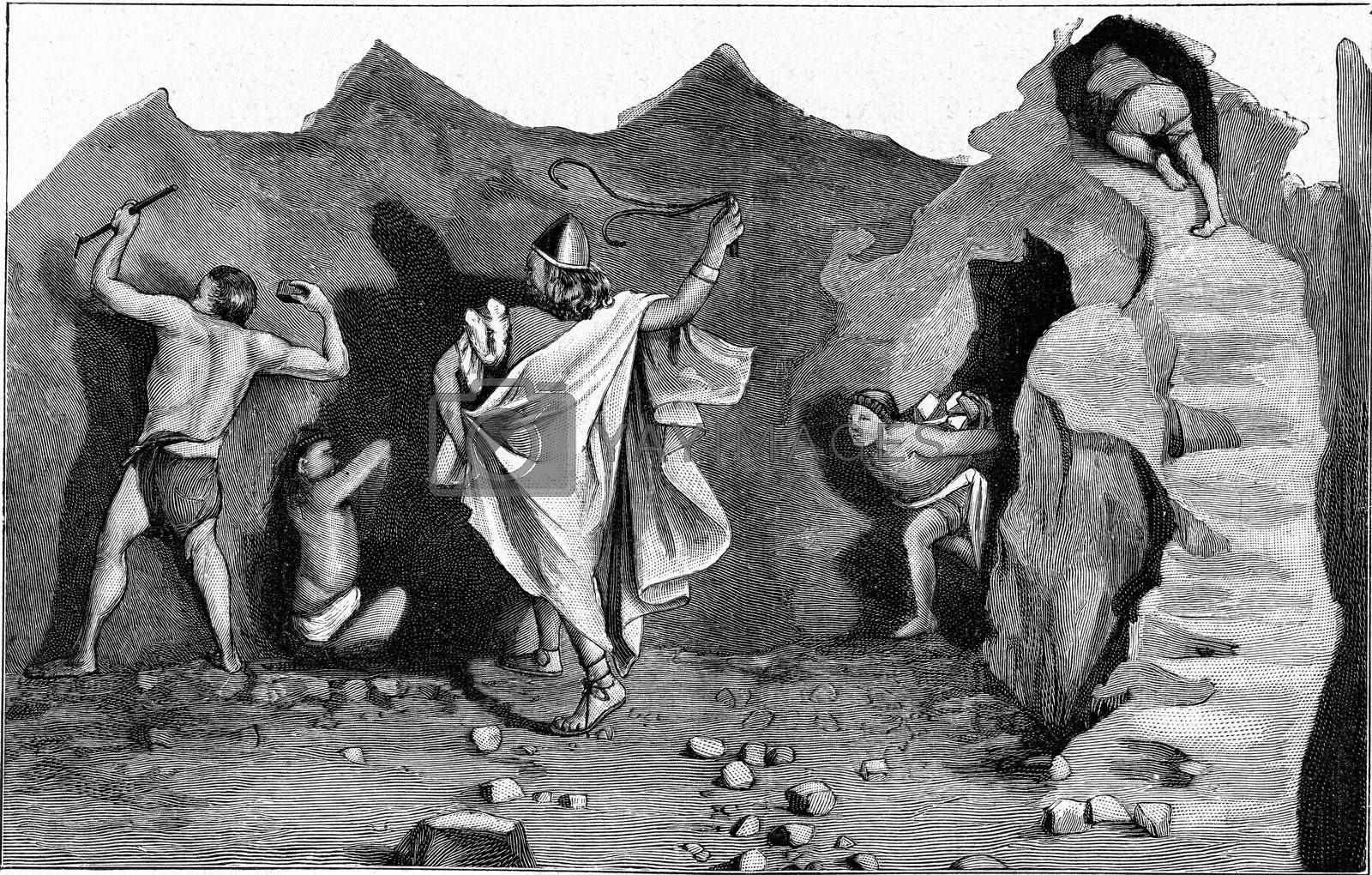 The work of slaves in a Phoenician copper mine, vintage engraved illustration. From the Universe and Humanity, 1910.