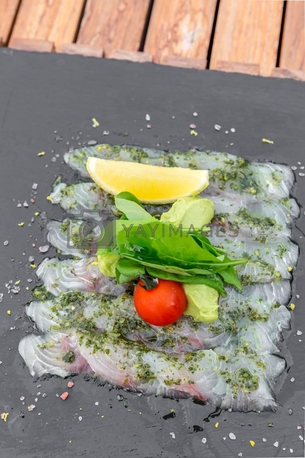 Sea bass sashimi mediterranean style cuisine