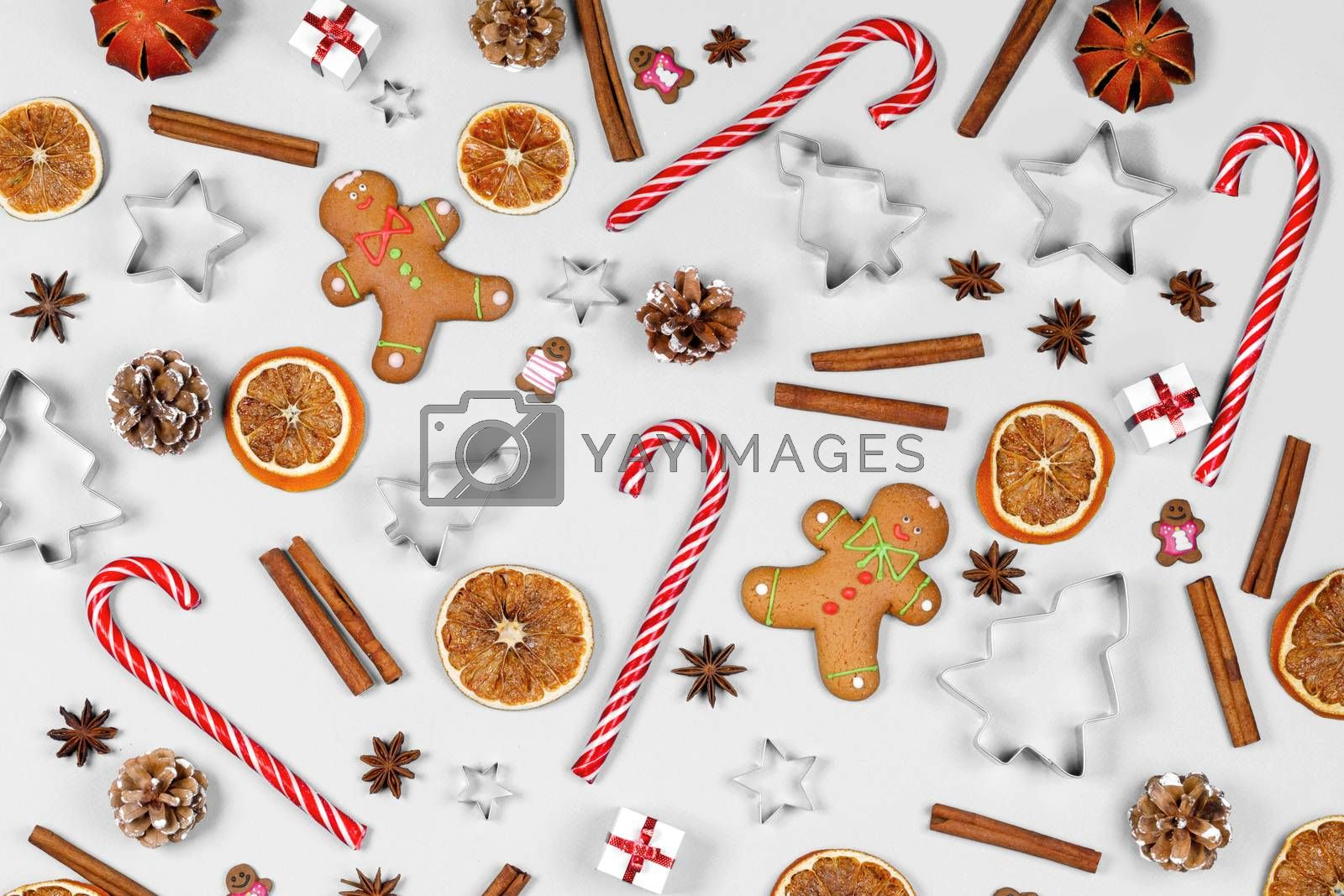 Christmas food frame. Gingerbread cookies, spices and decorations on white background with copy space