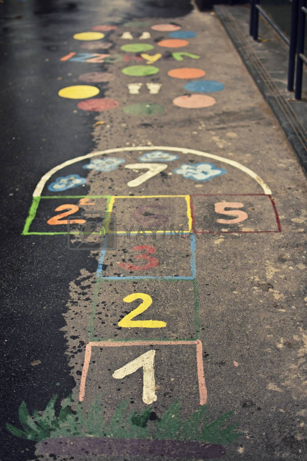 Children's hopscotch game with squares and numbers in different colors on the street.